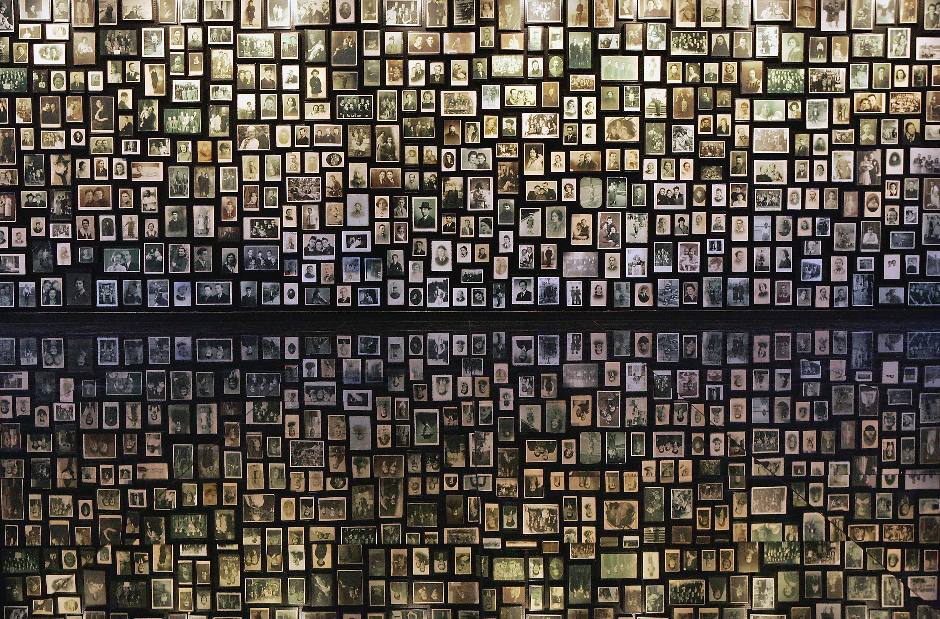 Photographs are displayed at the Birkenau Museum of the many faces of the men, women and children at the Auschwitz II - Birkenau which was built in March 1942 in the village of Brzezinka, Poland. The camp was liberated by the Soviet army on January 27, 1945, January 2005 will be the 60th anniversary of the liberation of the extermination and concentration camps, when survivors and victims who suffered as a result of the Holocaust will commemorated across the world. (Scott Barbour/Getty Images)