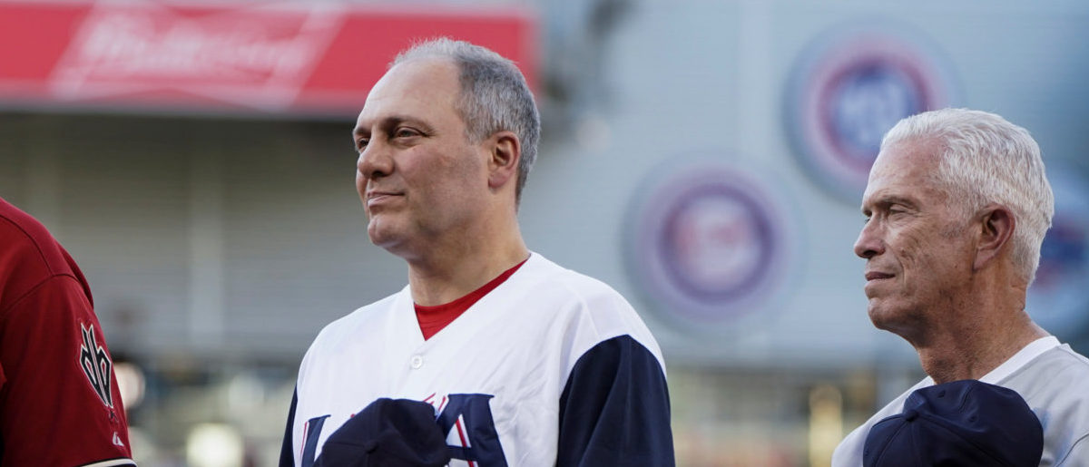 House Majority Whip Steve Scalise (R-LA) listens to the National Anthem prior to the annual Congressional Baseball game at Nationals Park in Washington, U.S., June 14, 2018. REUTERS/Toya Sarno Jordan