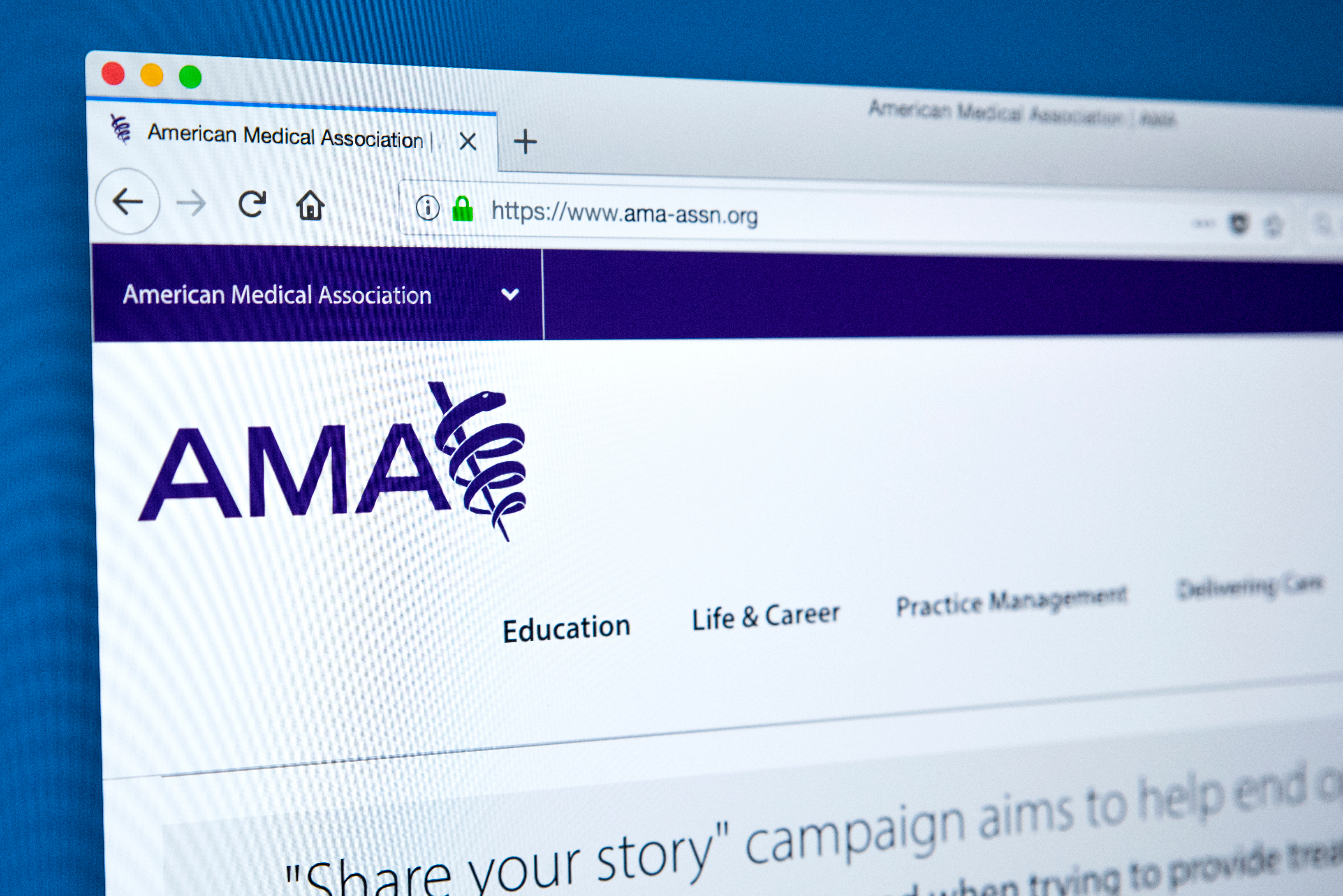 A screen shows the American Medical Association's webage. Shutterstock image via chrisdorney