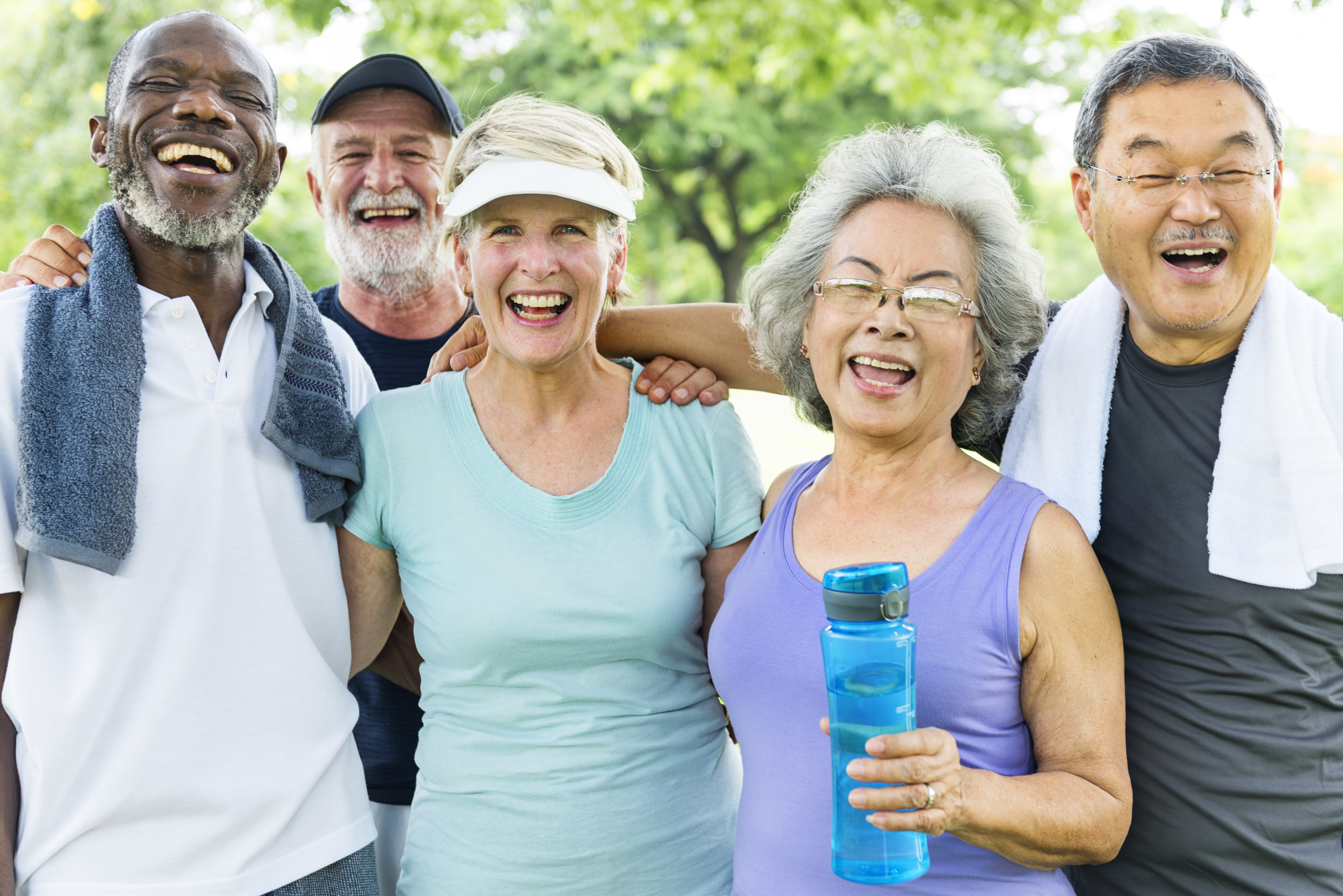 A group of seniors exercises together. Shutterstock image via Rawpixel.com