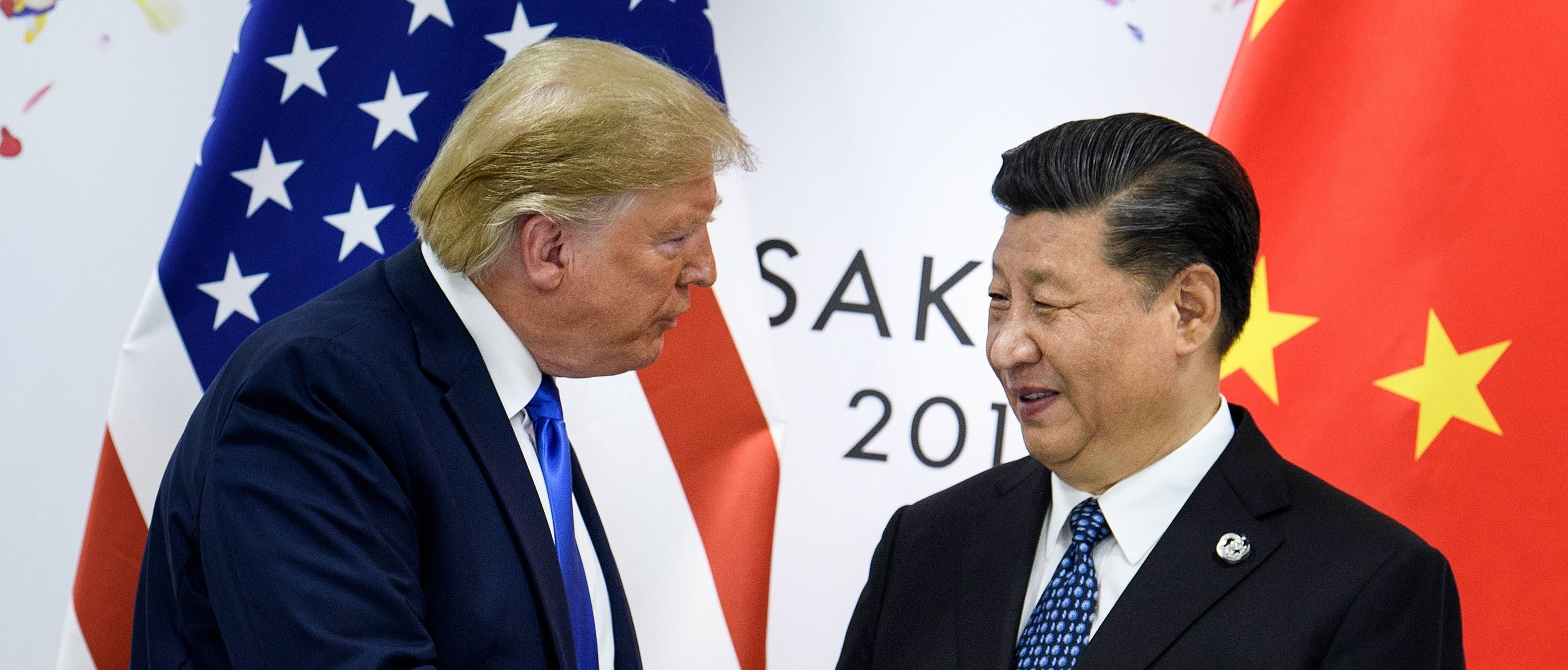 China's President Xi Jinping (R) shakes hands with US President Donald Trump before a bilateral meeting on the sidelines of the G20 Summit in Osaka on June 29, 2019. (BRENDAN SMIALOWSKI/AFP/Getty Images)