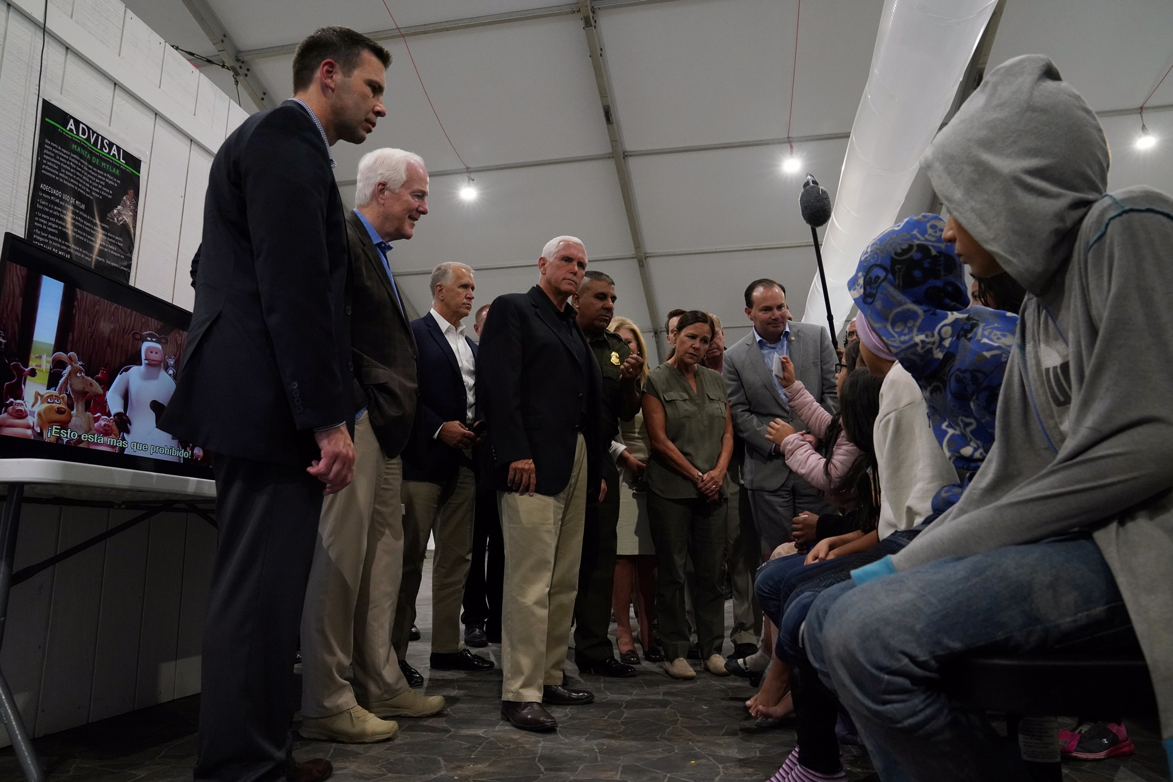 U.S. Vice President Mike Pence talks to young asylum-seekers at the Donna Soft-Sided Processing Facility in Donna, Texas, U.S. July 12, 2019. REUTERS/Veronica G. Cardenas