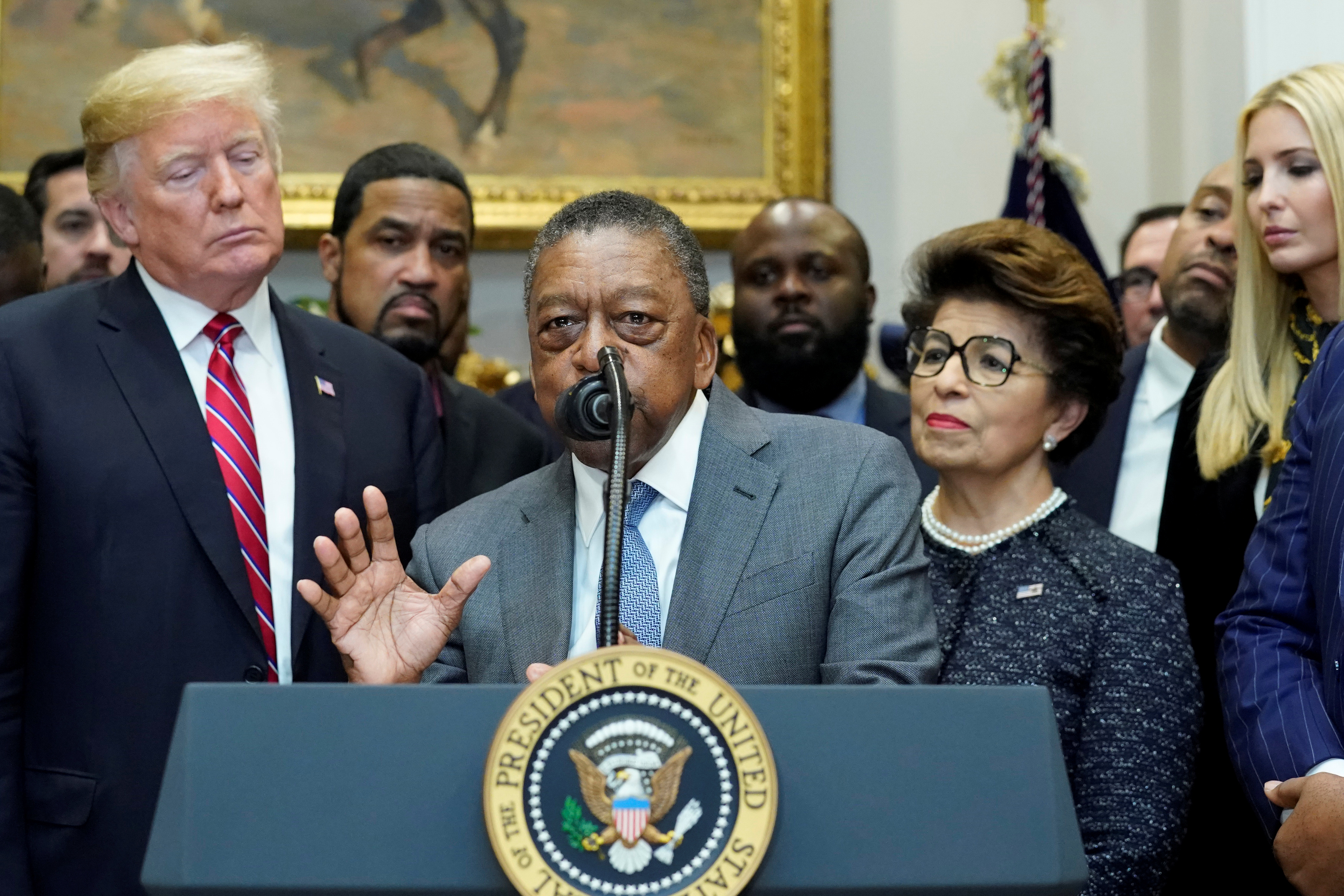 BET founder Robert Johnson, flanked by U.S. President Donald Trump, Treasurer of the U.S. Jovita Carranza and White House senior advisor Ivanka Trump, delivers remarks before Trump signs an Executive Order establishing the White House Opportunity and Revitalization Council at the White House in Washington, U.S. December 12, 2018. REUTERS/Jonathan Ernst