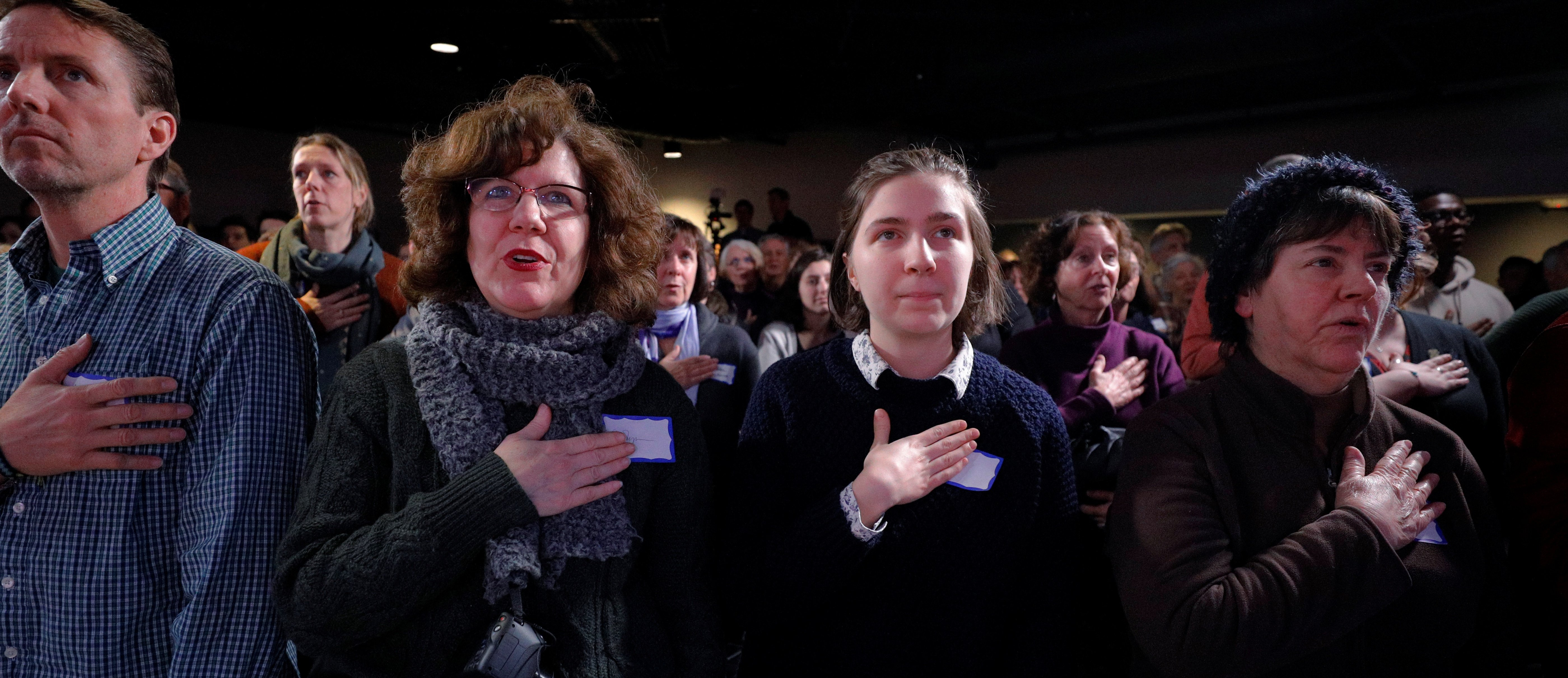 Audience members recite the U.S. pledge of allegiance before a campaign stop with Democratic 2020 U.S. presidential candidate and U.S. Senator Cory Booker (D-NJ) in Portsmouth, New Hampshire, U.S., February 16, 2019. REUTERS/Brian Snyder