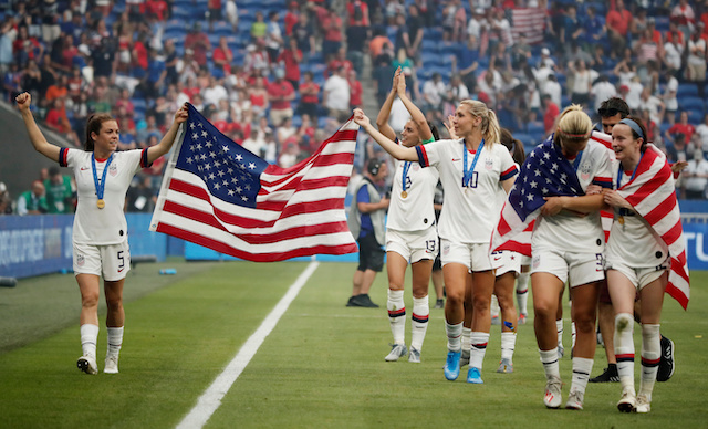 Soccer Football - Women's World Cup Final - United States v Netherlands - Groupama Stadium, Lyon, France - July 7, 2019 Kelley O'Hara of the U.S., Allie Long of the U.S. and team mates celebrate after winning the Women's World Cup REUTERS/Benoit Tessier