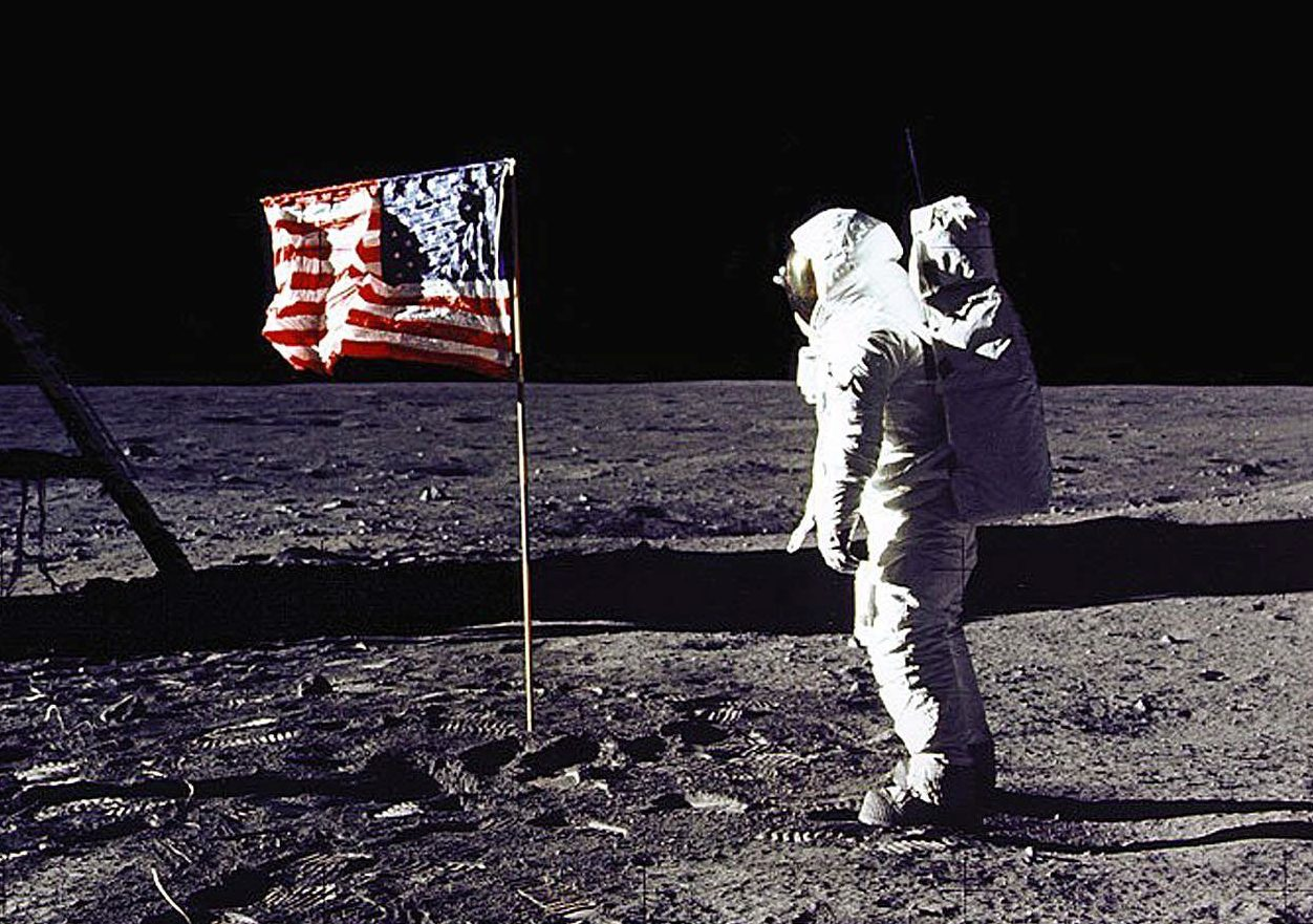 "This 20 July 1969 file photo released by NASA shows astronaut Edwin E. ""Buzz"" Aldrin, Jr. saluting the US flag on the surface of the Moon during the Apollo 11 lunar mission. The 20th July 1999 marks the 30th anniversary of the Apollo 11 mission and man's first walk on the Moon. (Photo by NASA/AFP/Getty Images)"