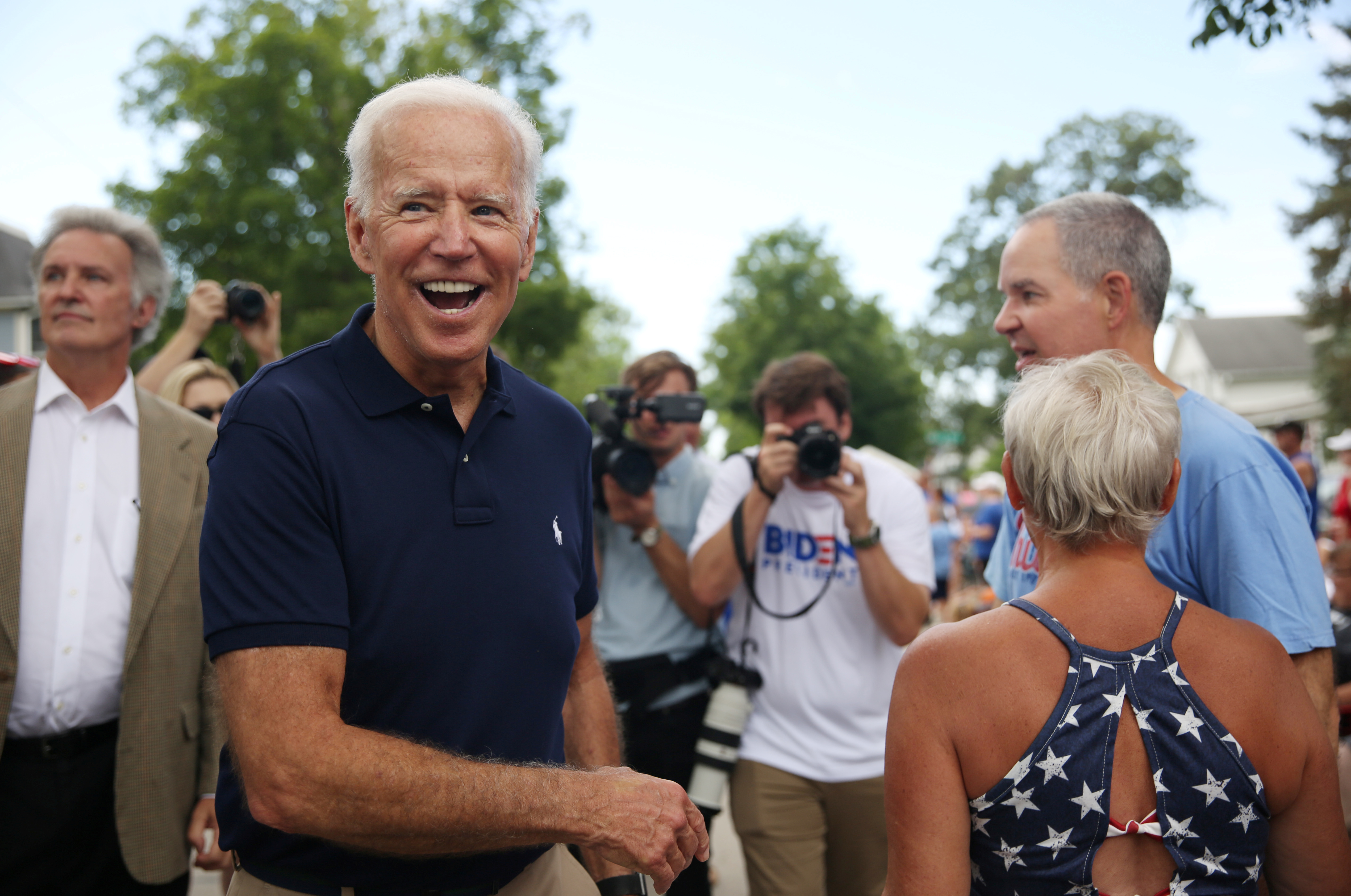 Democratic 2020 U.S. presidential candidate and former Vice President Joe Biden greets supporters at the Independence Day parade in Independence, Iowa