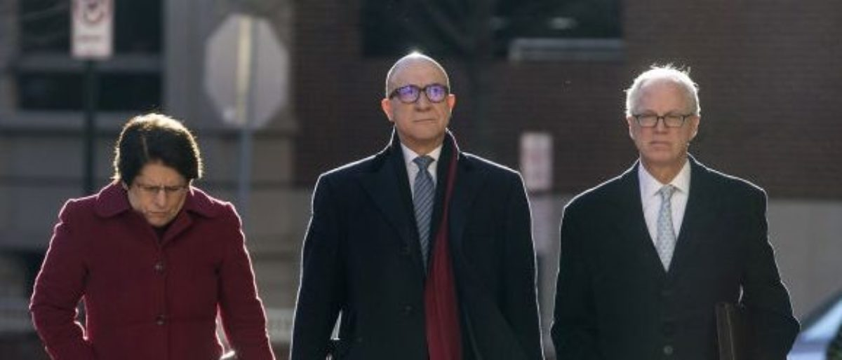 Bijan Rafiekian, also known as Bijan Kian, center, arrives at the U.S. District Court in Alexandria, Virginia, U.S., on Tuesday, Dec. 18. 2018. Kian and Kamil Ekim Alptekin, associates of former National Security Adviser Michael Flynn, were accused of helping the government of President Recep Tayyip Erdogan retaliate against a political opponent, and then concealing the government's involvement. Photographer: Zach Gibson/Bloomberg via Getty Images