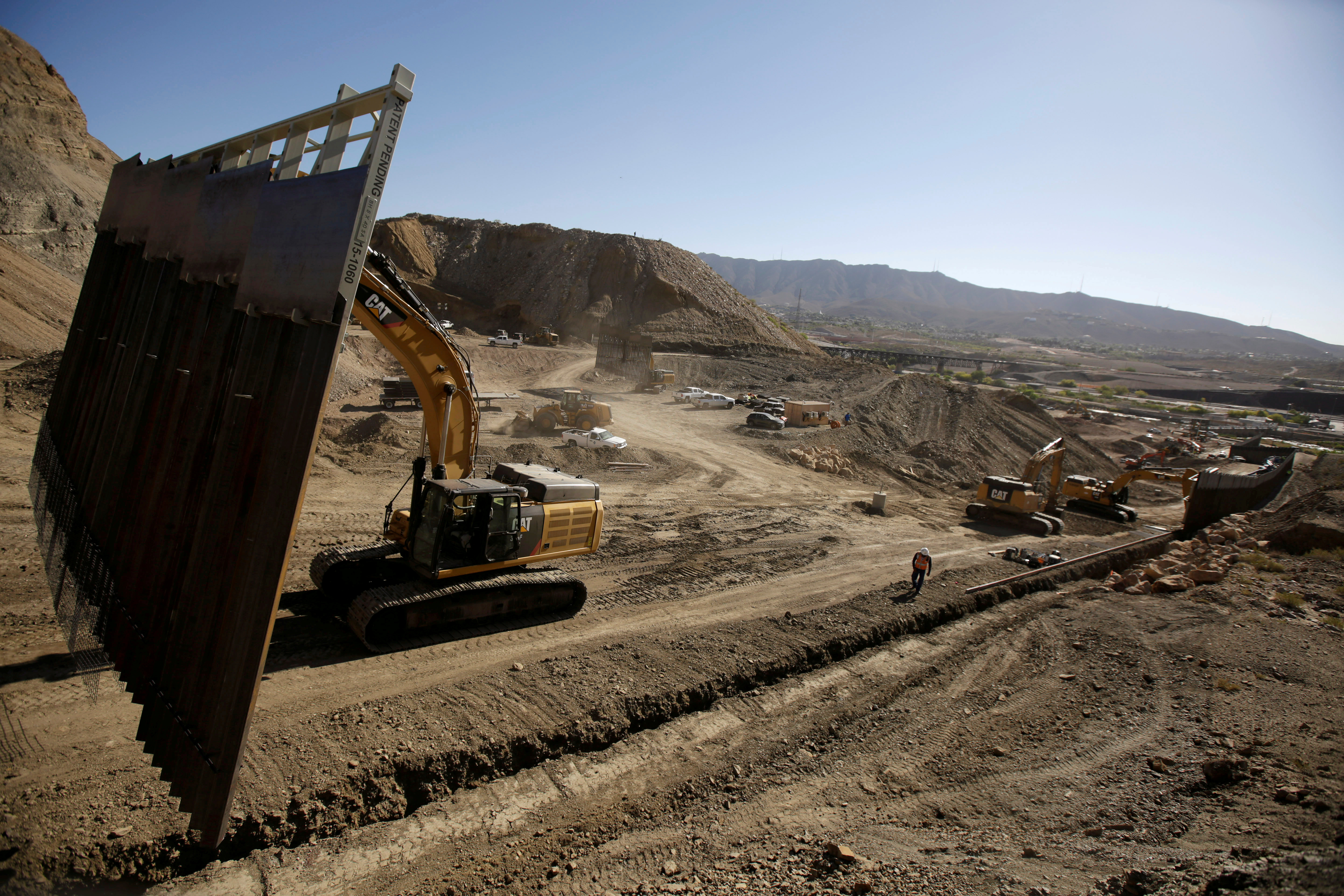 FILE PHOTO: Heavy machinery moves a bollard-type wall, to be placed along the border of private property using funds raised from a GoFundMe account, at Sunland Park, N.M., as seen from Ciudad Juarez