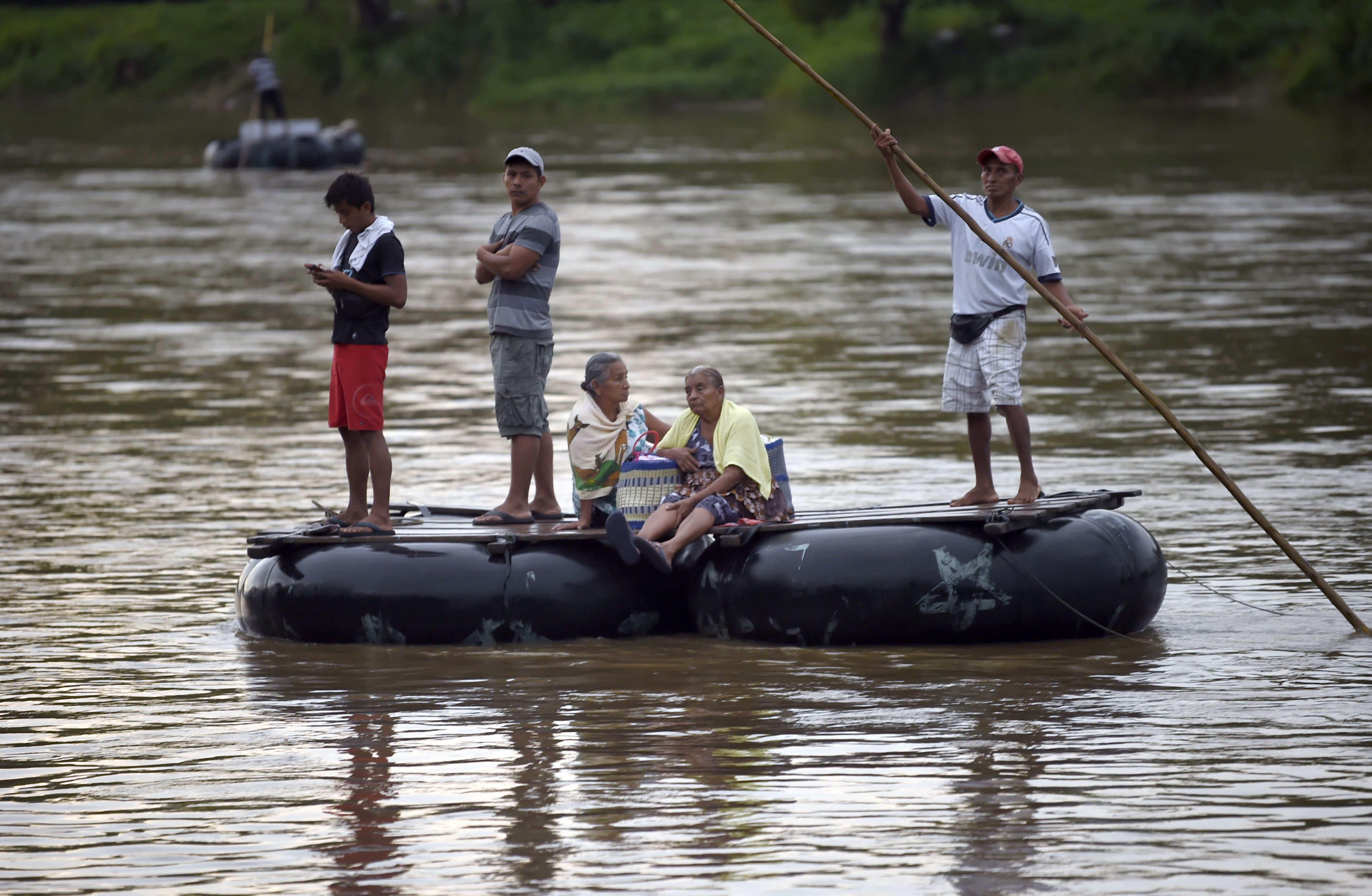 Guatemalan migrants use a makeshift raft to illegally cross the Suchiate river from Guatemala to Mexico, on July 22, 2019. (Alfredo Estrella/AFP/Getty Images)
