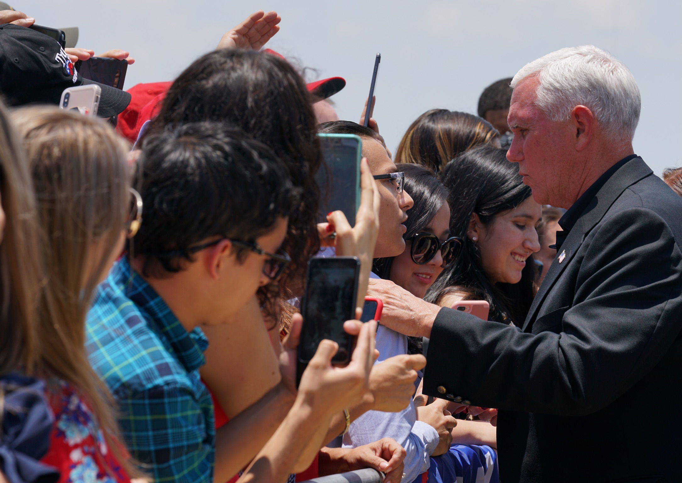U.S. Vice President Mike Pence talks to his supporters as he arrives at the airport in McAllen, Texas, U.S. July 12, 2019. REUTERS/Veronica G. Cardenas