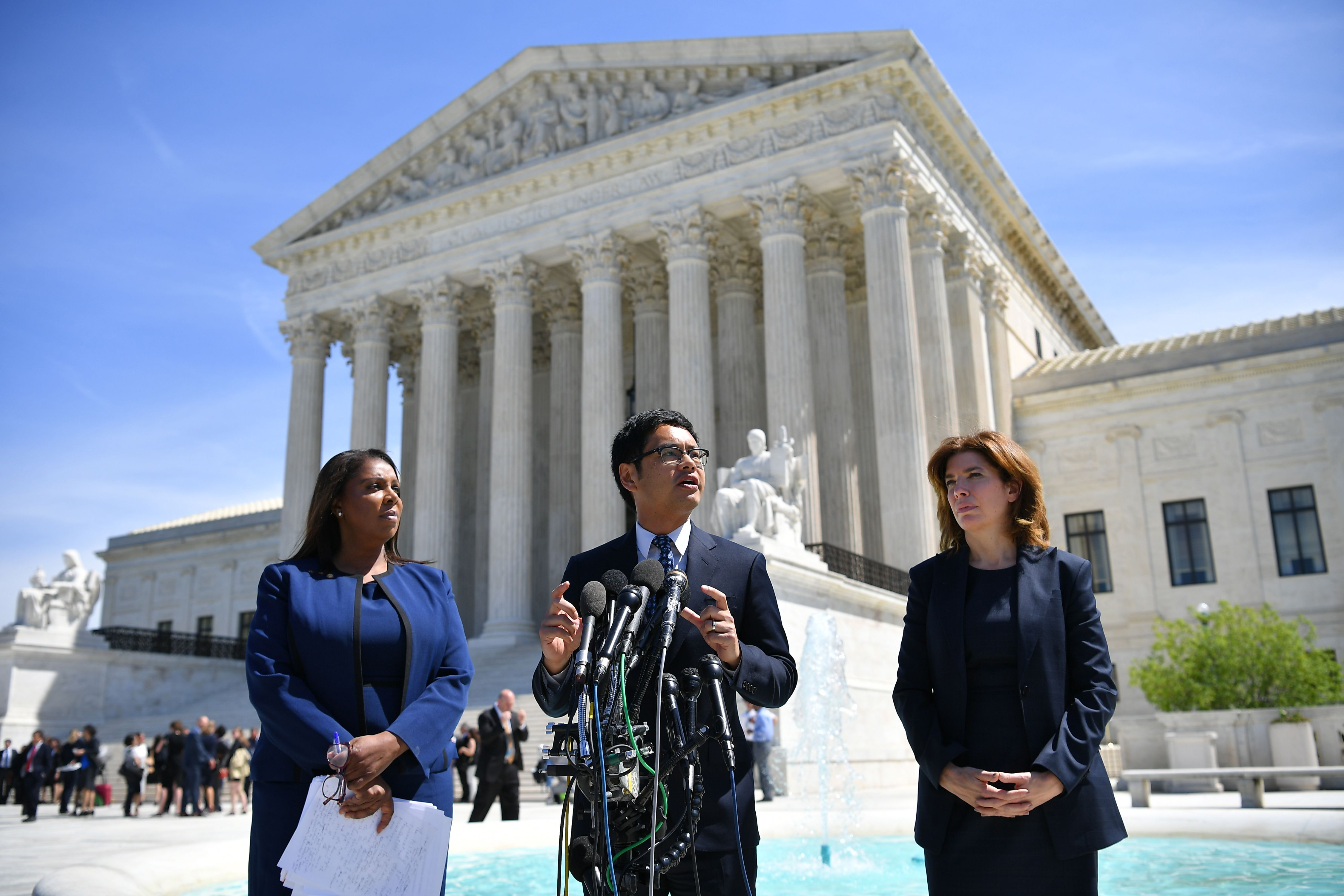 Dale Ho of the ACLU flanked by New York Attorney General Letitia James (L) and New York City census director Julie Menin (R) speaks to reporters outside of the Supreme Court on April 23, 2019. (Mandel Ngan/AFP/Getty Images)