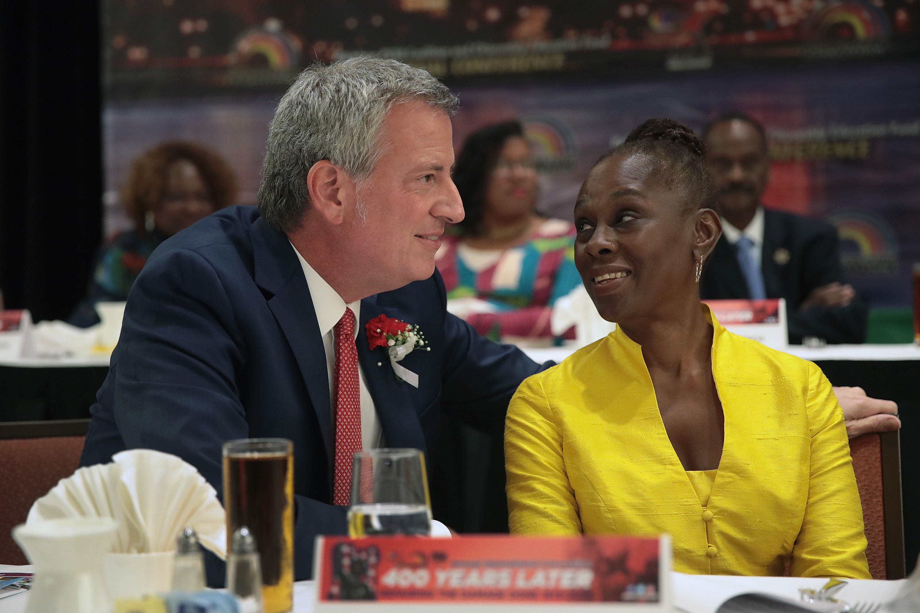 Democratic presidential candidate and New York City mayor Bill De Blasio speaks to his wife Chirlane McCray at the Rainbow PUSH Coalition Annual International Convention on July 1, 2019 in Chicago, Illinois. (Scott Olson/Getty Images)