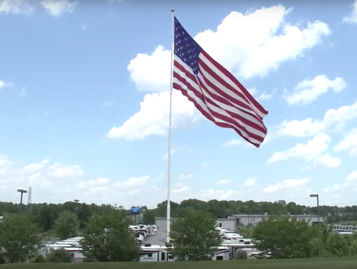 Camping World CEO Marcus Lemonis says he's willing to go to jail before he takes down a giant American flag flying over the Gander RV store in Statesville, North Carolina. Photo Youtube screenshot.