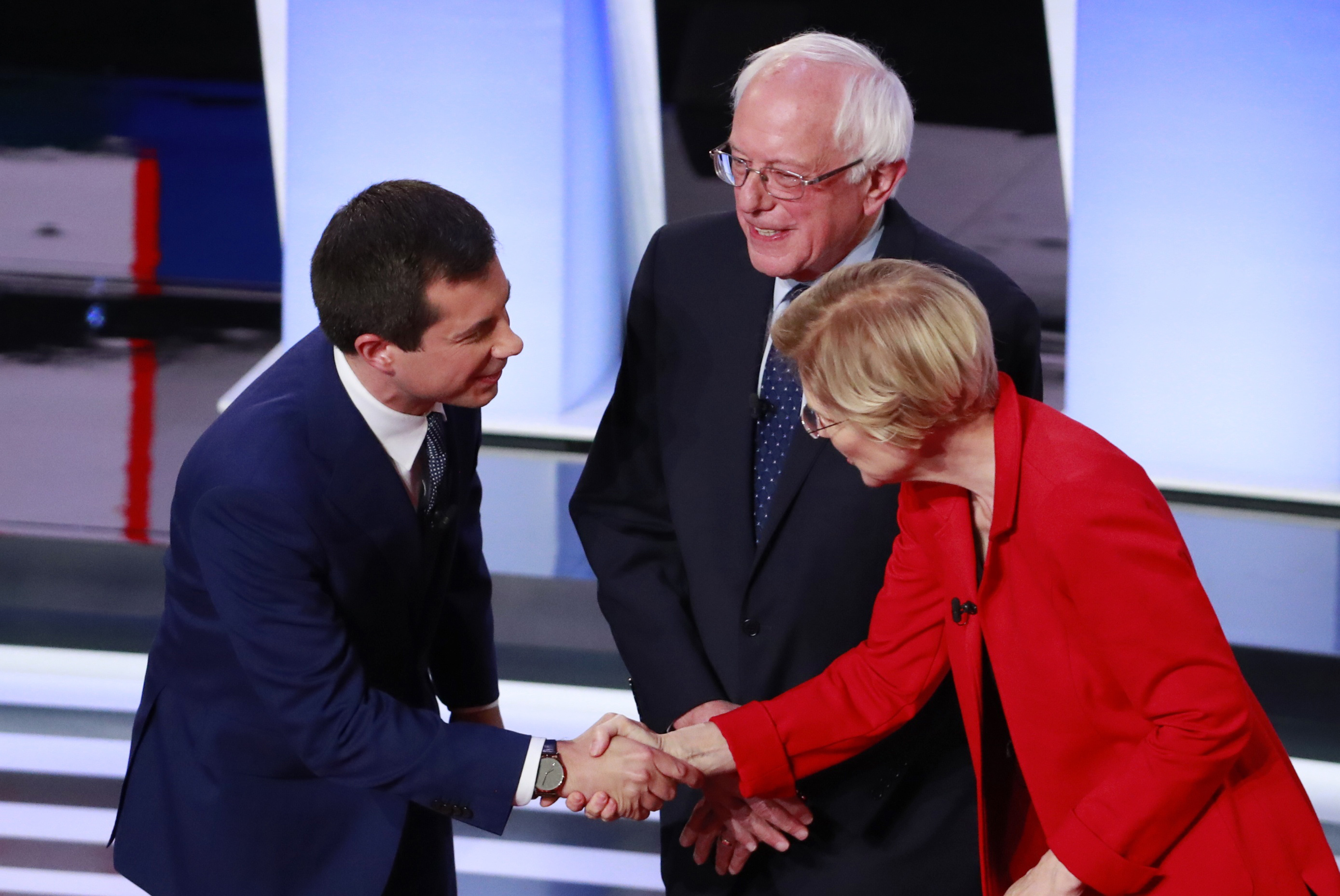Candidates shake hands before the start of the first night of the second 2020 Democratic U.S. presidential debate in Detroit, Michigan, U.S.