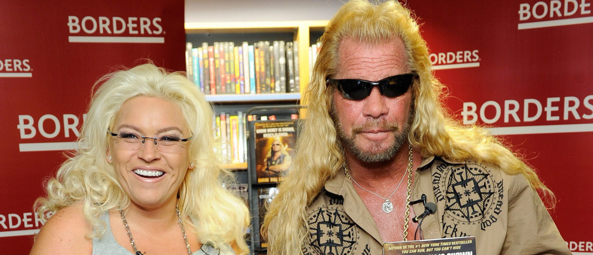 "Media personality Duane Chapman (right), known in the media as ""Dog the Bounty Hunter"" is joined by his wife Beth Chapman as he promotes his book ""When Mercy Is Shown, Mercy Is Given"" at Borders Wall Street on March 19, 2010 in New York City. (Photo by Jemal Countess/Getty Images)"