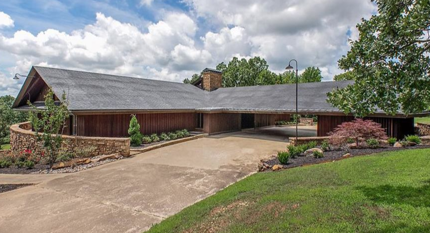Michelle and Jim Bob Duggar have listed a 10,000-square foot property in Springdale, Arkansas that includes three kitchens and a gun closet. Photo courtesy of Realtor.com