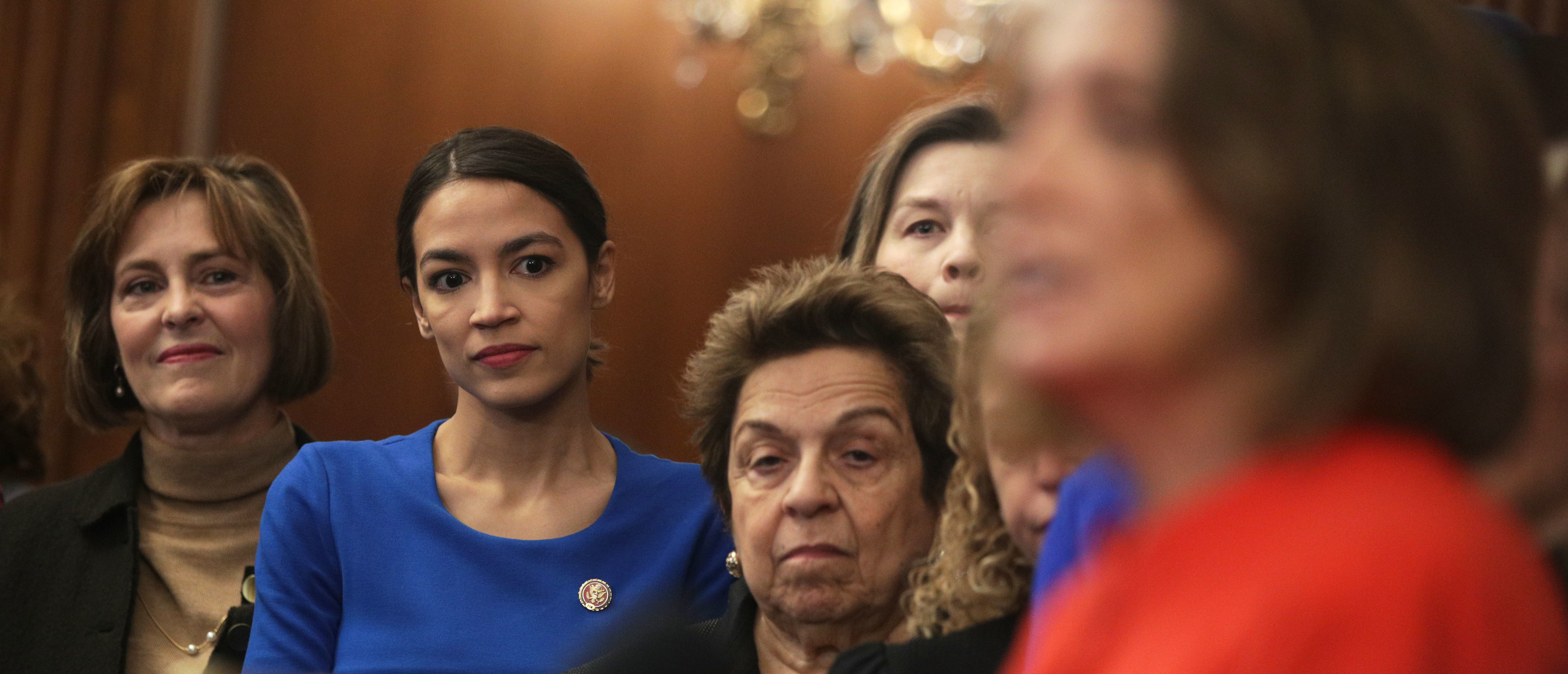 "WASHINGTON, DC - JANUARY 30: (L-R) U.S. Rep. Kathy Castor (D-FL), Rep. Alexandria Ocasio-Cortez (D-NY), and Rep. Donna Shalala (D-FL) listen as Speaker of the House Rep. Nancy Pelosi (D-CA) speaks during a news conference at the U.S. Capitol January 30, 2019 in Washington, DC. House Democrats held a news conference to introduce the ""Paycheck Fairness Act."" (Photo by Alex Wong/Getty Images)"