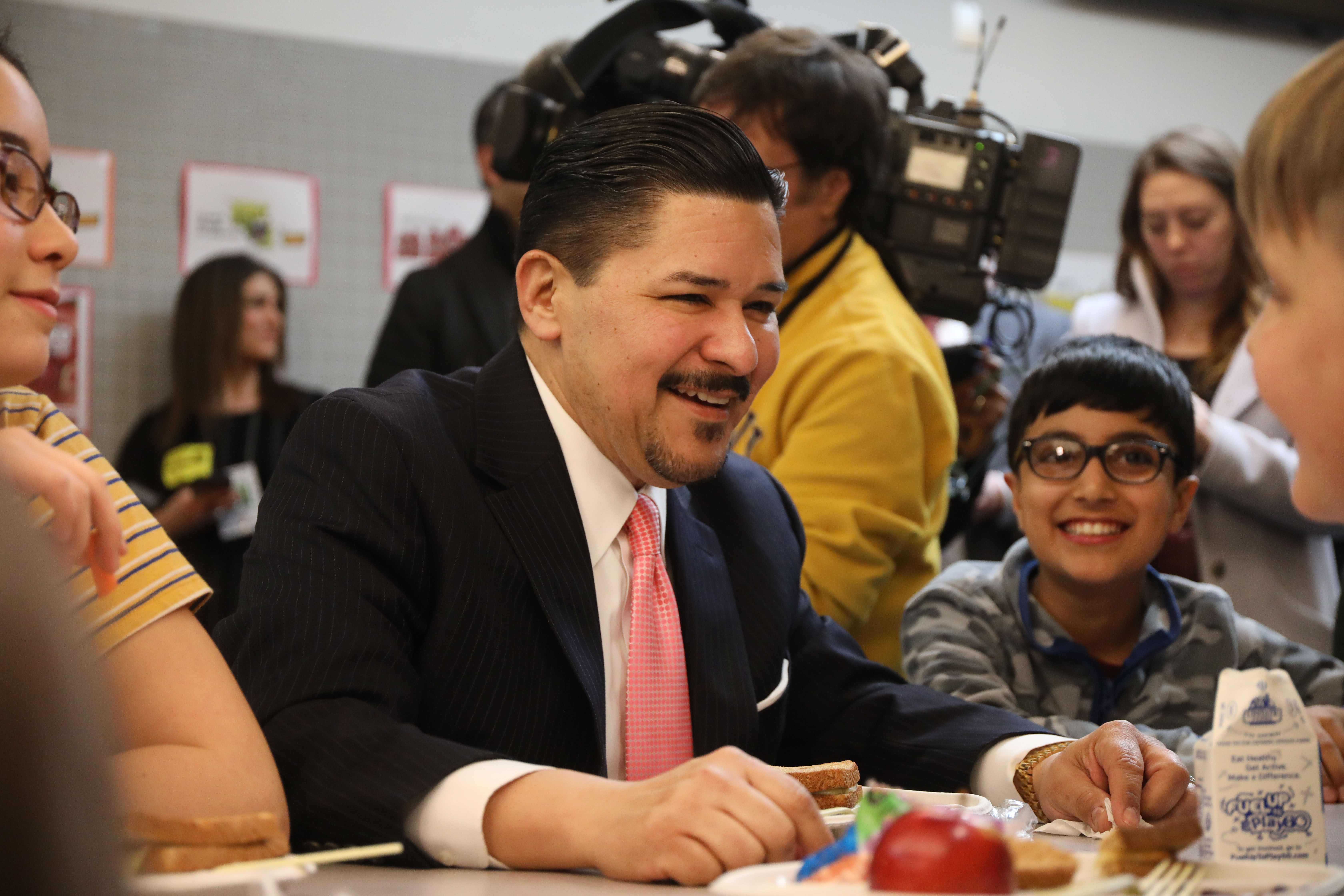 NEW YORK, NEW YORK - MARCH 11: Schools Chancellor Richard Carranza joins New York Mayor Bill de Blasio and school children for lunch at PS130, a Brooklyn public school, for an announcement about Meatless Monday's on March 11, 2019 in New York City. Citing healthy eating habits for children and the environmental impact of too much meat in our diet, Mayor de Blasio and Schools Chancellor Carranza will begin having all public school serve an all vegetarian menus on Mondays beginning in the 2019-2020 school year. (Photo by Spencer Platt/Getty Images)
