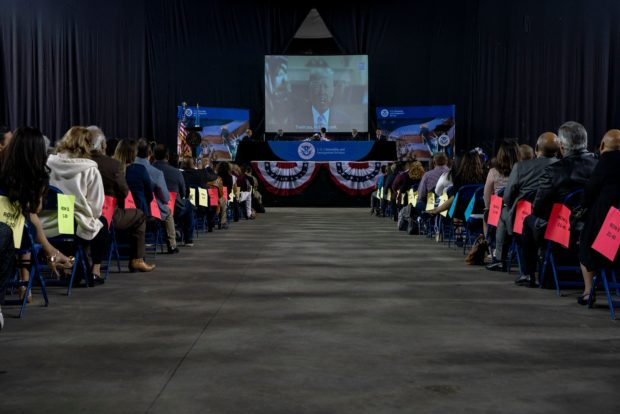 Immigrants taking the oath to be US citizens listen to a recorded message from US President Donald Trump, congratulating them on becoming citizens during the Naturalization Ceremony at El Paso County Coliseum, in El Paso, Texas on April 18, 2019. - About 740 immigrants from countries all over the world were sworn in as United States Citizens. (Photo by PAUL RATJE/AFP/Getty Images)