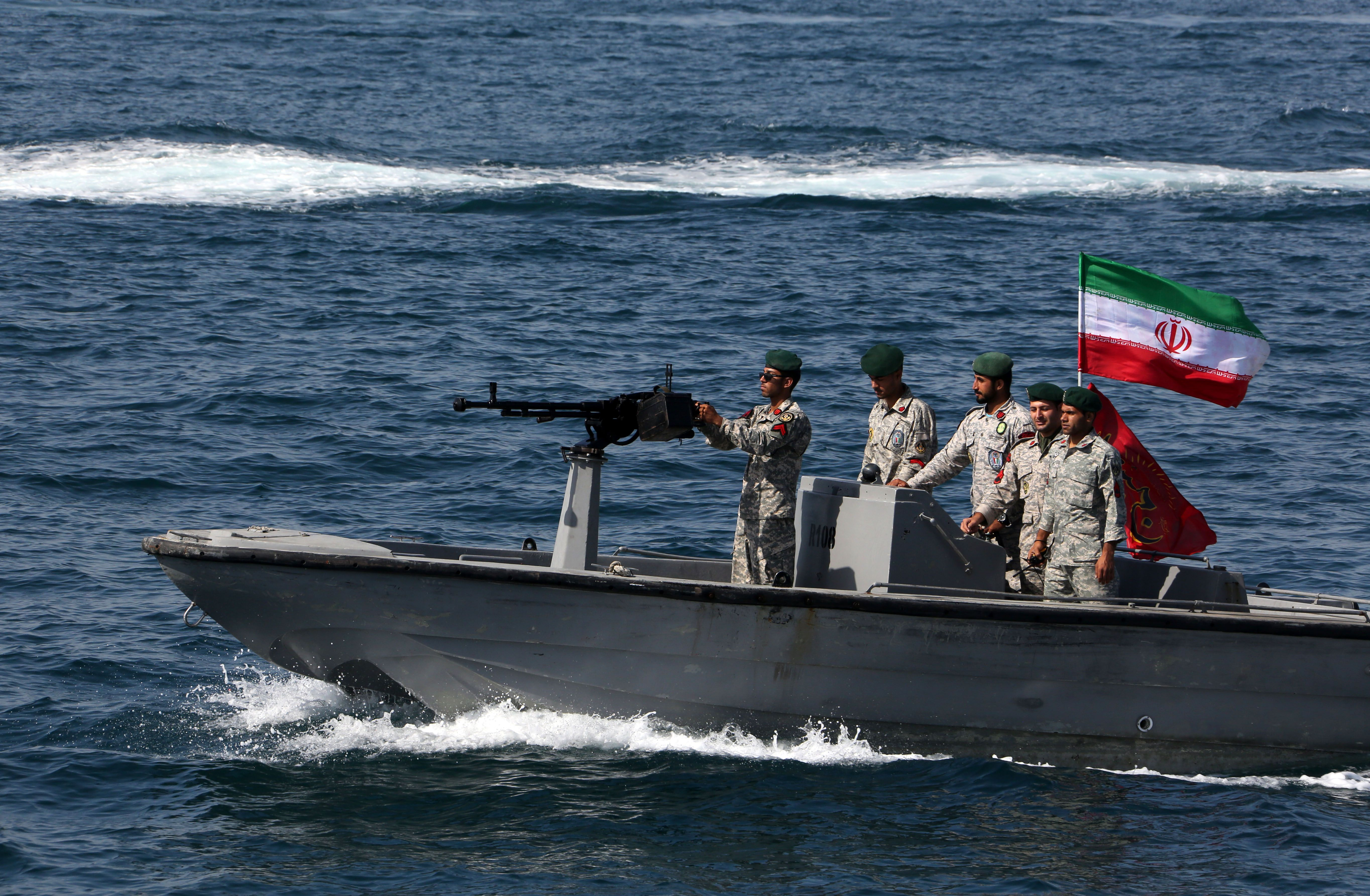 "Iranian soldiers take part in the ""National Persian Gulf day"" in the Strait of Hormuz, on April 30, 2019. - The date coincides with the anniversary of a successful military campaign by Shah Abbas the Great of Persia in the 17th century, which drove the Portuguese navy out of the Hormuz Island, after which is named the waterway which separates the Gulf from the Sea of Oman. (Photo by ATTA KENARE / AFP) (Photo credit should read ATTA KENARE/AFP/Getty Images)"