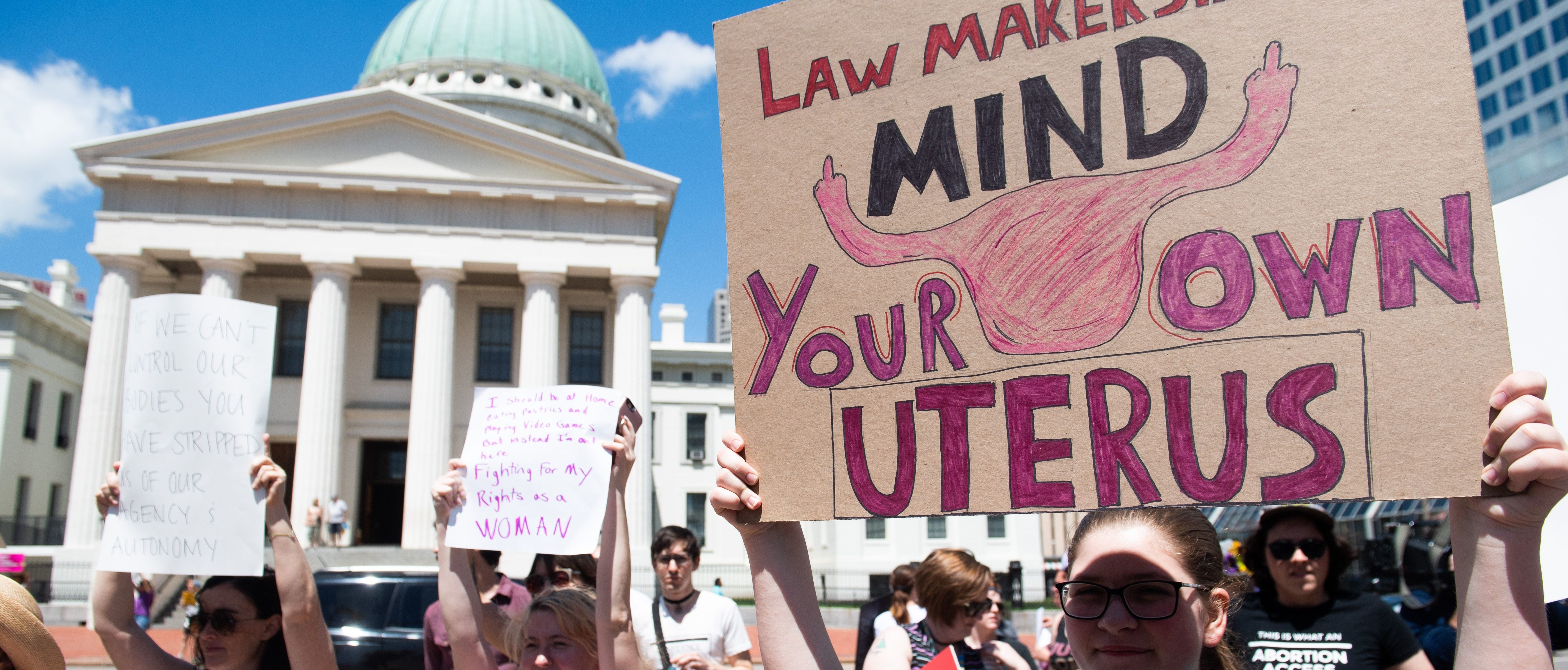 TOPSHOT - Thousands of demonstrators march in support of Planned Parenthood and pro-choice as they protest a state decision that would effectively halt abortions by revoking the license of the last center in the state that performs the procedure, during a rally in St. Louis, Missouri, May 30, 2019. (Photo by SAUL LOEB / AFP) (Photo credit should read SAUL LOEB/AFP/Getty Images)