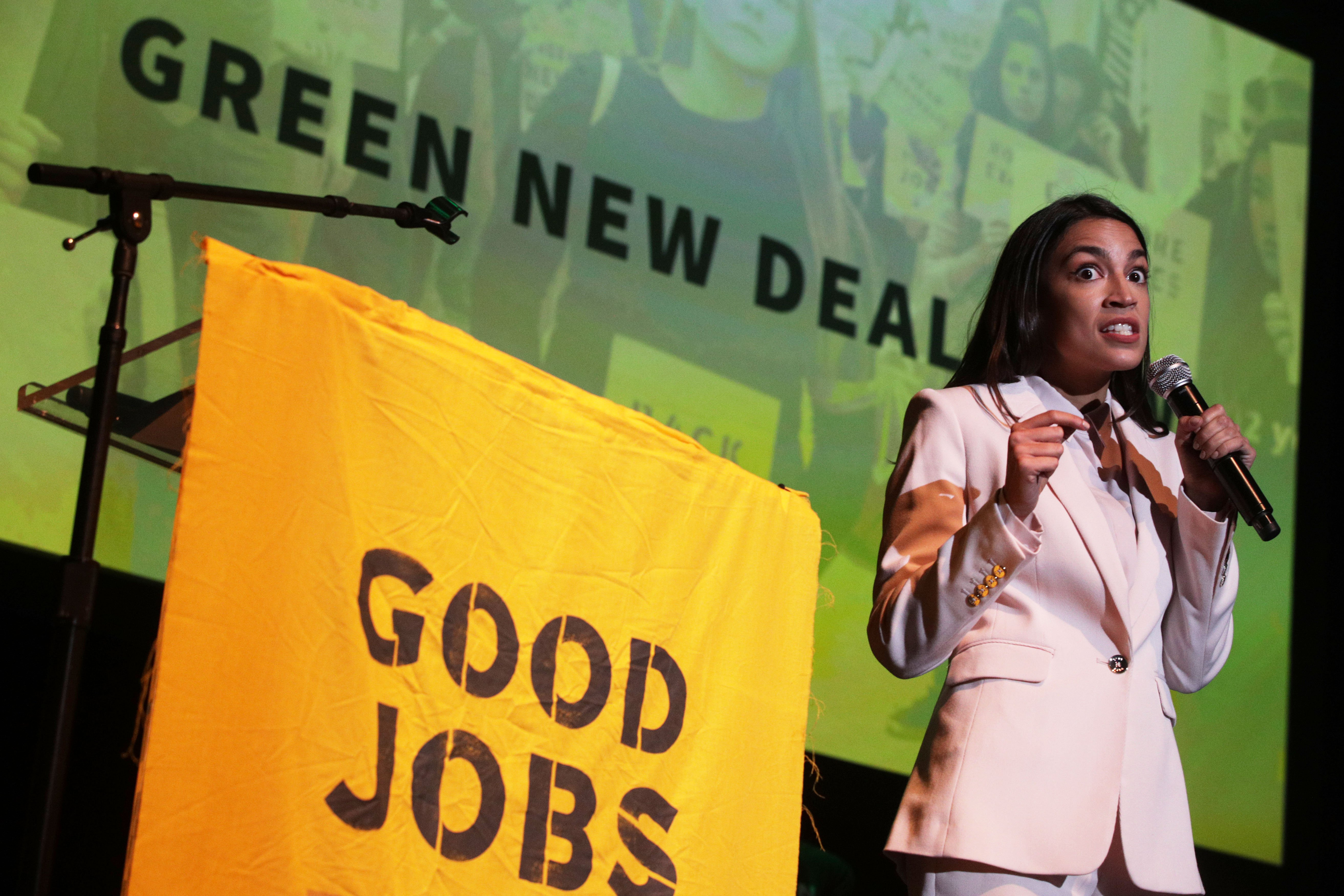 "U.S. Rep. Alexandria Ocasio-Cortez (D-NY) speaks during a rally at Howard University May 13, 2019 in Washington, DC. The Sunrise Movement held an event for the final stop of the ""Road to a Green New Deal"" tour to ""explore what the pain of the climate crisis looks like in D.C. and for the country and what the promise of the Green New Deal means."" (Photo by Alex Wong/Getty Images)"