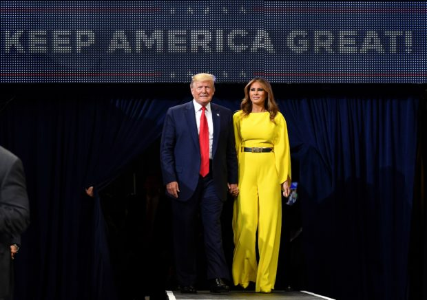 US President Donald Trump and First Lady Melania Trump arrive for the official launch of the Trump 2020 campaign at the Amway Center in Orlando, Florida on June 18, 2019. - Trump kicks off his reelection campaign at what promised to be a rollicking evening rally in Orlando. (Photo by MANDEL NGAN/AFP/Getty Images)
