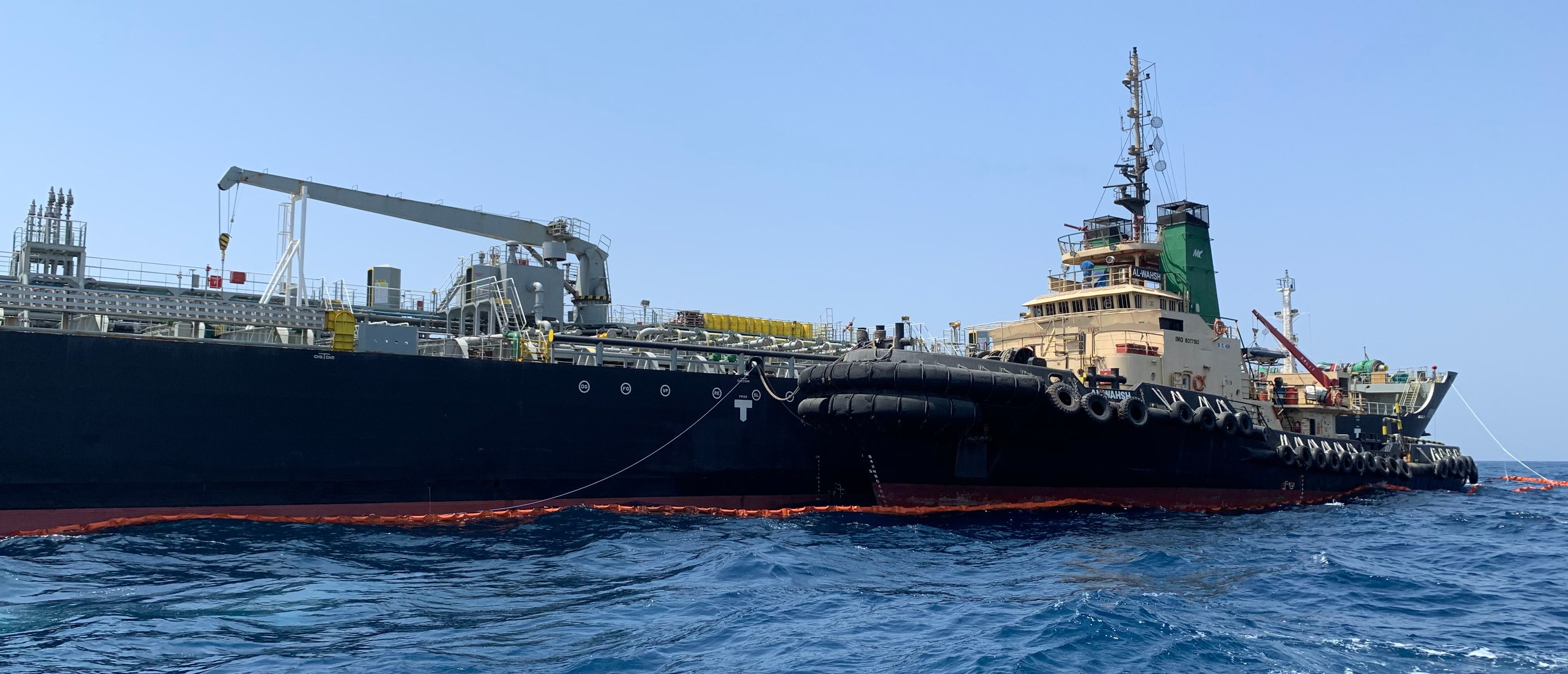 "A picture taken during a guided tour by the U.S. Navy (NAVCENT) shows the Japanese oil tanker Kokuka Courageous off the port of the Gulf emirate of Fujairah on June 19, 2019. - The Japanese tanker attacked in the Gulf of Oman last week was damaged by a limpet mine resembling Iranian mines, the US military in the Middle East said today. Commander Sean Kido of the US Navy told reporters that the US military has recovered biometric information of the assailants on the Japanese ship including ""hand and finger prints."" Two oil tankers were damaged in twin attacks close to the Iranian coast on June 13, just outside the strategic Strait of Hormuz. (Photo: MUMEN KHATIB/AFP/Getty Images)"