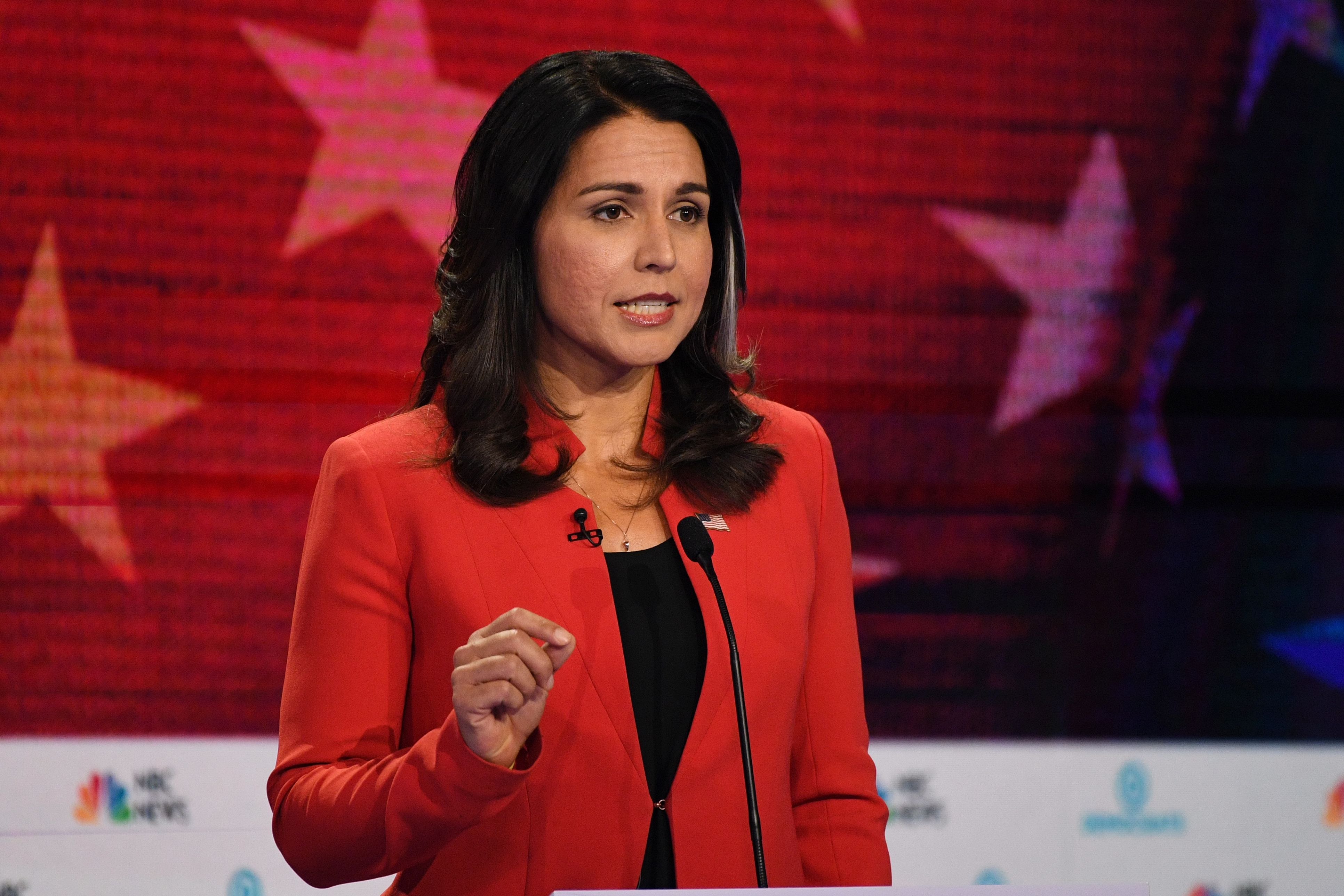 Democratic presidential hopeful US Representative for Hawaii's 2nd congressional district Tulsi Gabbard gestures as she speaks during the first Democratic primary debate of the 2020 presidential campaign season (JIM WATSON/AFP/Getty Images)