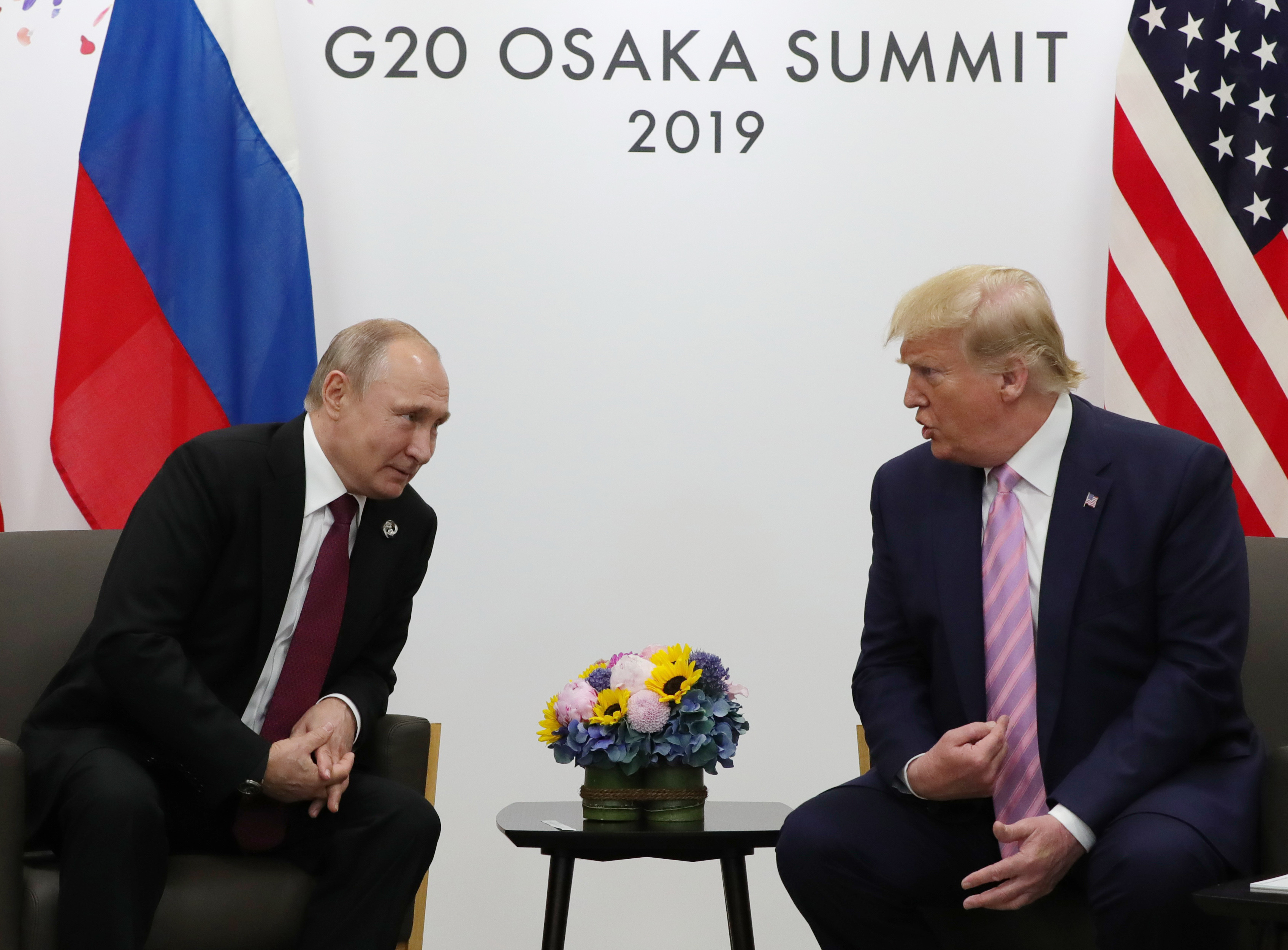 Russian President Vladimir Putin and US President Donald Trump hold a meeting on the sidelines of the G20 summit in Osaka on June 28, 2019. (MIKHAIL KLIMENTYEV/AFP/Getty Images)
