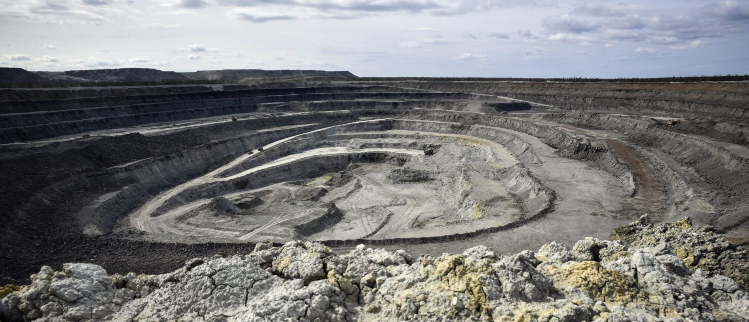 A view of Botuobinsky diamond mining pit of Nakyn diamond ore field, some 340 kms North-East from the town of Mirny on July 2, 2019. The Botuobinsky diamond mining pit has now depth of 130 meters, with a project depth of 580 meters, having 6,2 carats of diamonds per one tonne of kimberlite ore in this pipe. Russian Alrosa gets its diamonds in the permafrost abyssal holes dug with explosives in the permanently frozen ground of Yakutia, an isolated region in East Siberia, the home to the huge diamond deposits that ensure Russia's supremacy in world production. (Photo by Alexander NEMENOV / AFP / Getty Images)