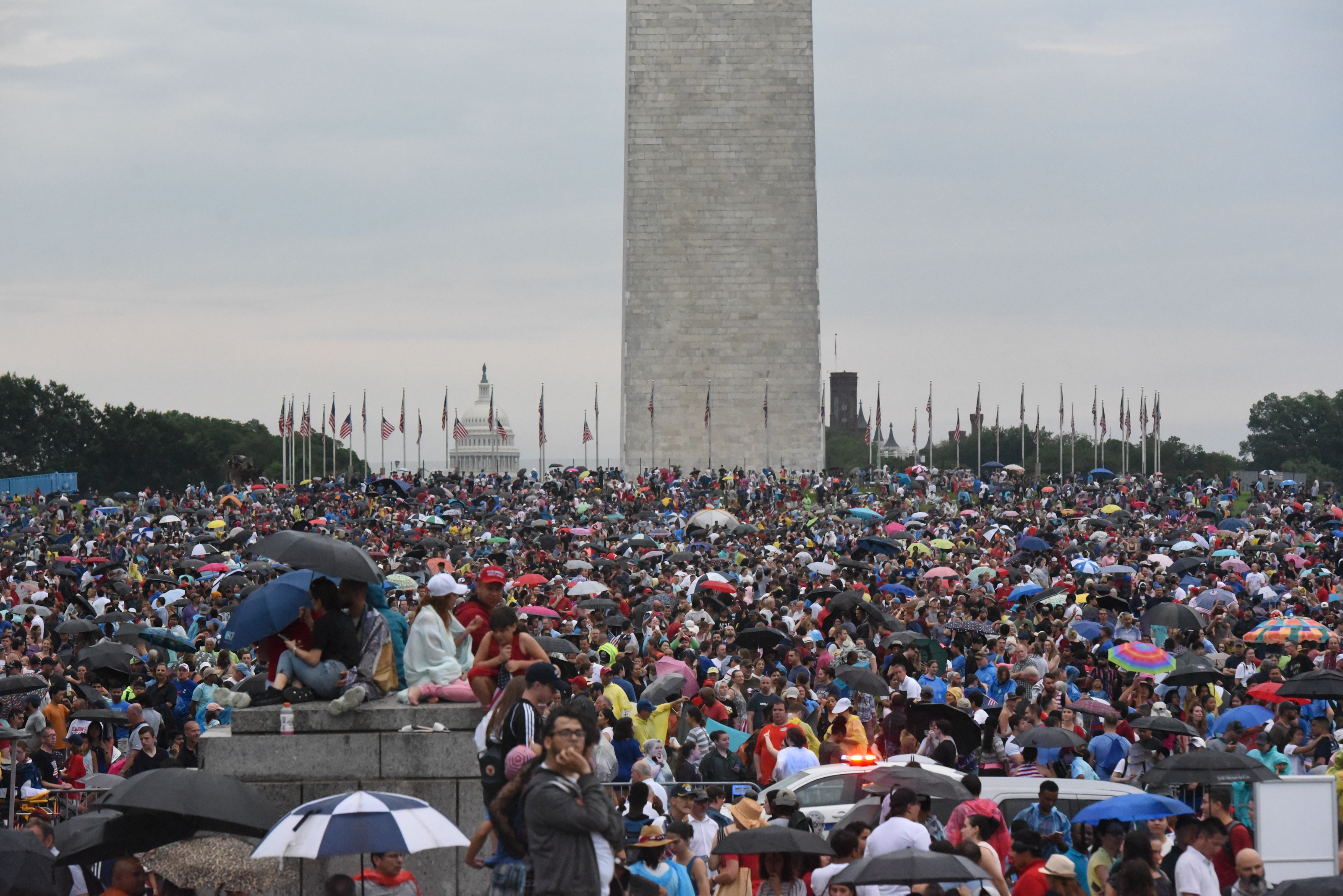 WASHINGTON, DC - JULY 04: People gather on the National Mall while President Donald Trump gives his speech during Fourth of July festivities on July 4, 2019 in Washington, DC. (Photo by Stephanie Keith/Getty Images)
