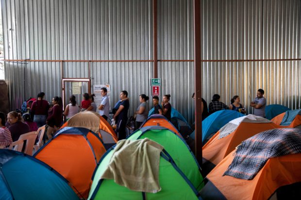 Tents are piled up in a hangar at Juventud 2000 migrant shelter in Tijuana, Baja California state, Mexico on July 13, 2019. - Asylum seekers in the US are overflowing shelters in Mexico waiting for their claims to be processed. (Photo by EDUARDO JARAMILLO CASTRO/AFP/Getty Images)
