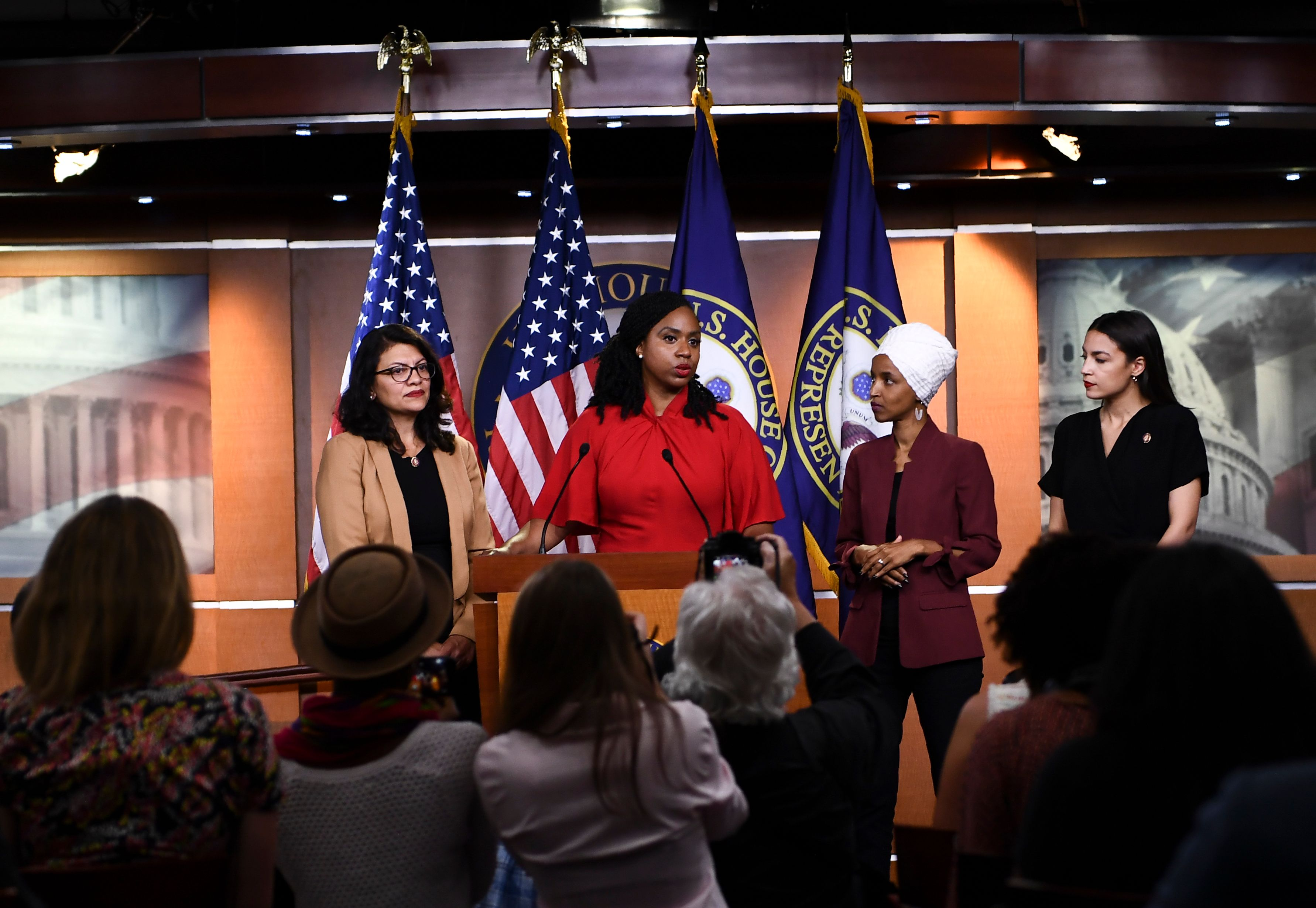 US Representatives Ayanna Pressley speaks as, Ilhan Omar, Rashida Tlaib, and Alexandria Ocasio-Cortez look on during a press conference, to address remarks made by US President Donald Trump earlier in the day, at the US Capitol in Washington, DC on July 15, 2019.(BRENDAN SMIALOWSKI/AFP/Getty Images)