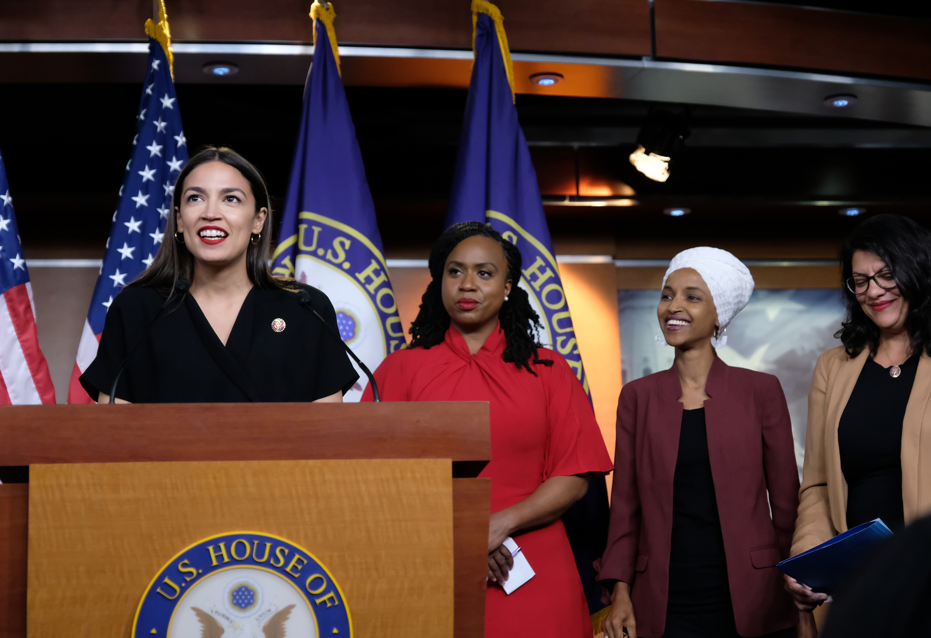 "U.S. Rep. Alexandria Ocasio-Cortez (D-NY) speaks as Reps. Ayanna Pressley (D-MA), Ilhan Omar (D-MN), and Rashida Tlaib (D-MI) listen during a press conference at the U.S. Capitol on July 15, 2019 in Washington, DC. President Donald Trump stepped up his attacks on four progressive Democratic congresswomen, saying if they're not happy in the United States ""they can leave."" (Photo by Alex Wroblewski/Getty Images)"