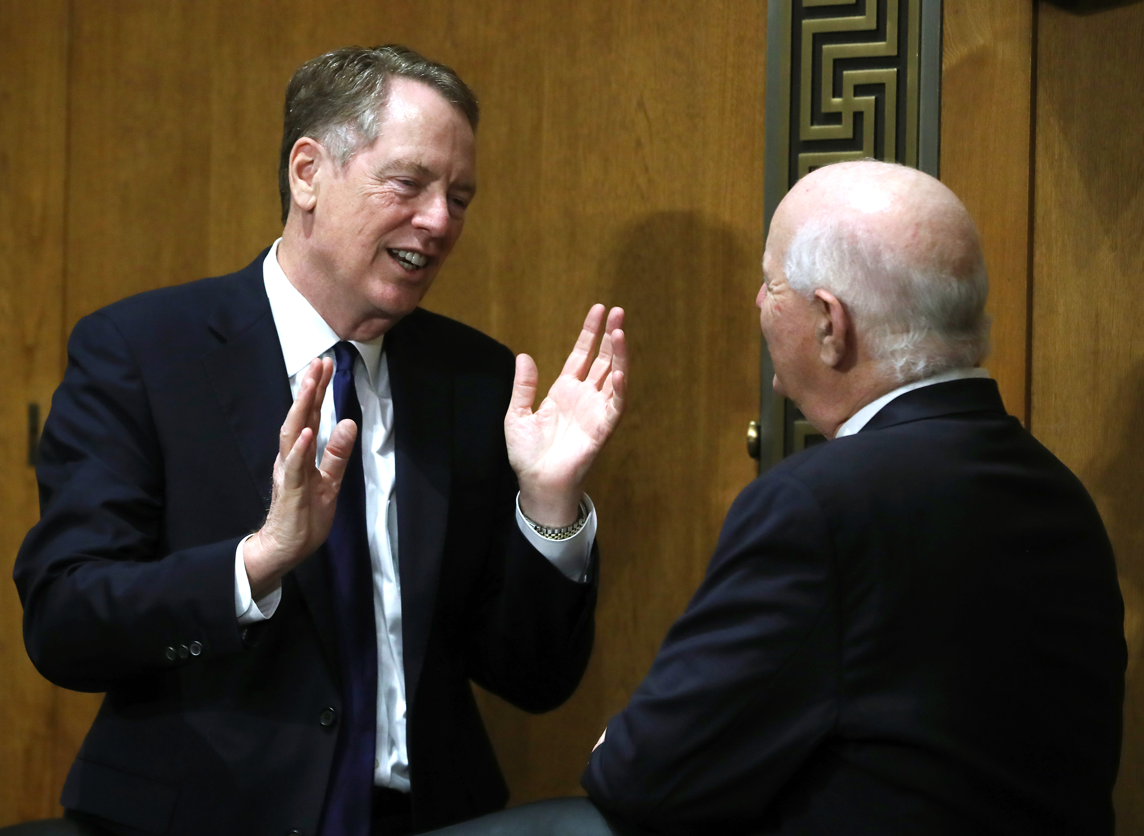 U.S. Trade RepresentativeRobert Lighthizer(L) talks with Sen. Ben Cardin during a Senate Finance Committee hearing on June 18, 2019 in Washington, DC. (Photo by Mark Wilson/Getty Images)