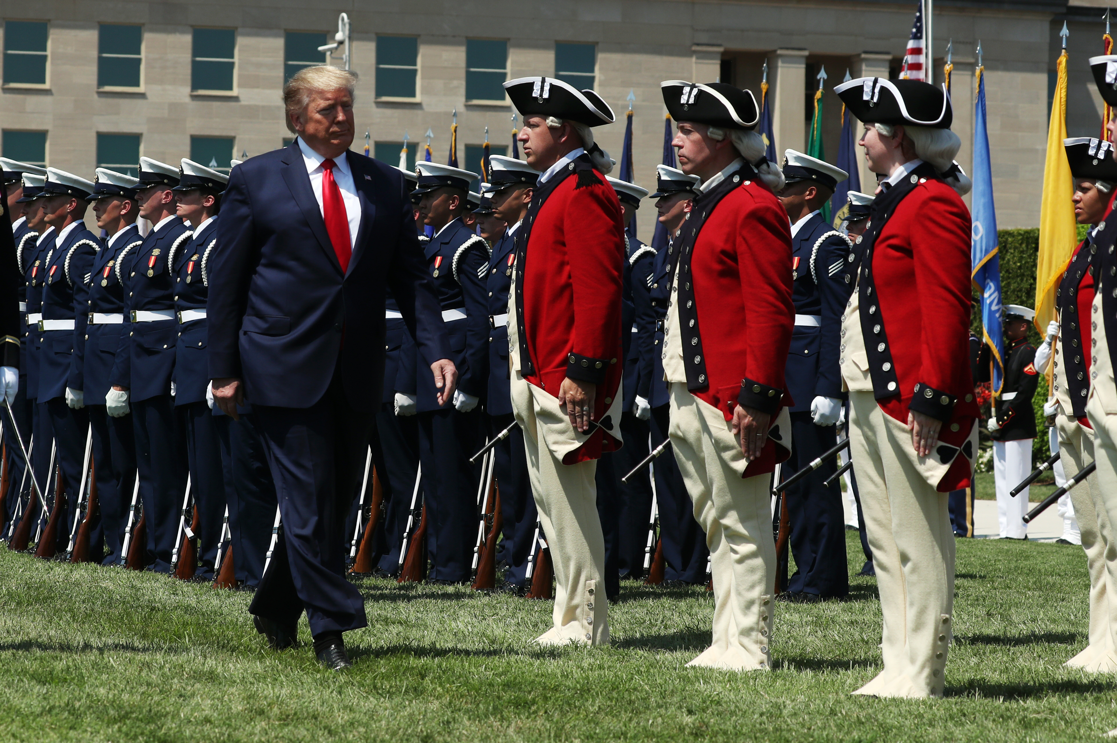 ARLINGTON, VA - JULY 25: U.S. President Donald Trump inspects the troops during a full honors welcome ceremony on the parade grounds at the Pentagon, on July 25, 2019 in Arlington, Virginia. Earlier this week Esper was sworn in as the 27th Secretary of Defense. (Photo by Mark Wilson/Getty Images)