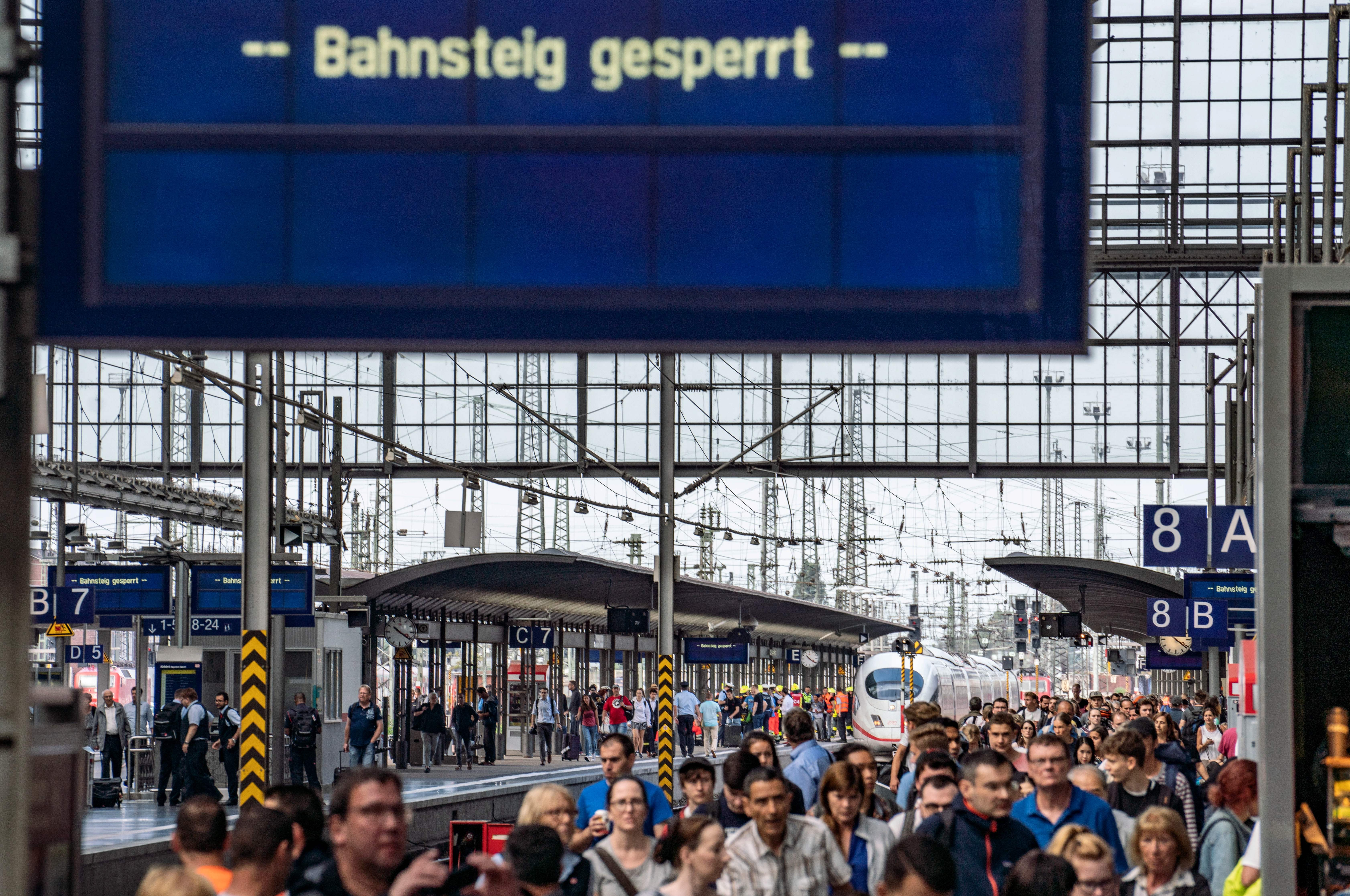 Frankfurt's main station is crowded with passengers as police and medical helpers stand next to an ICE speed train (background) on July 29, 2019. (FRANK RUMPENHORST/AFP/Getty Images)