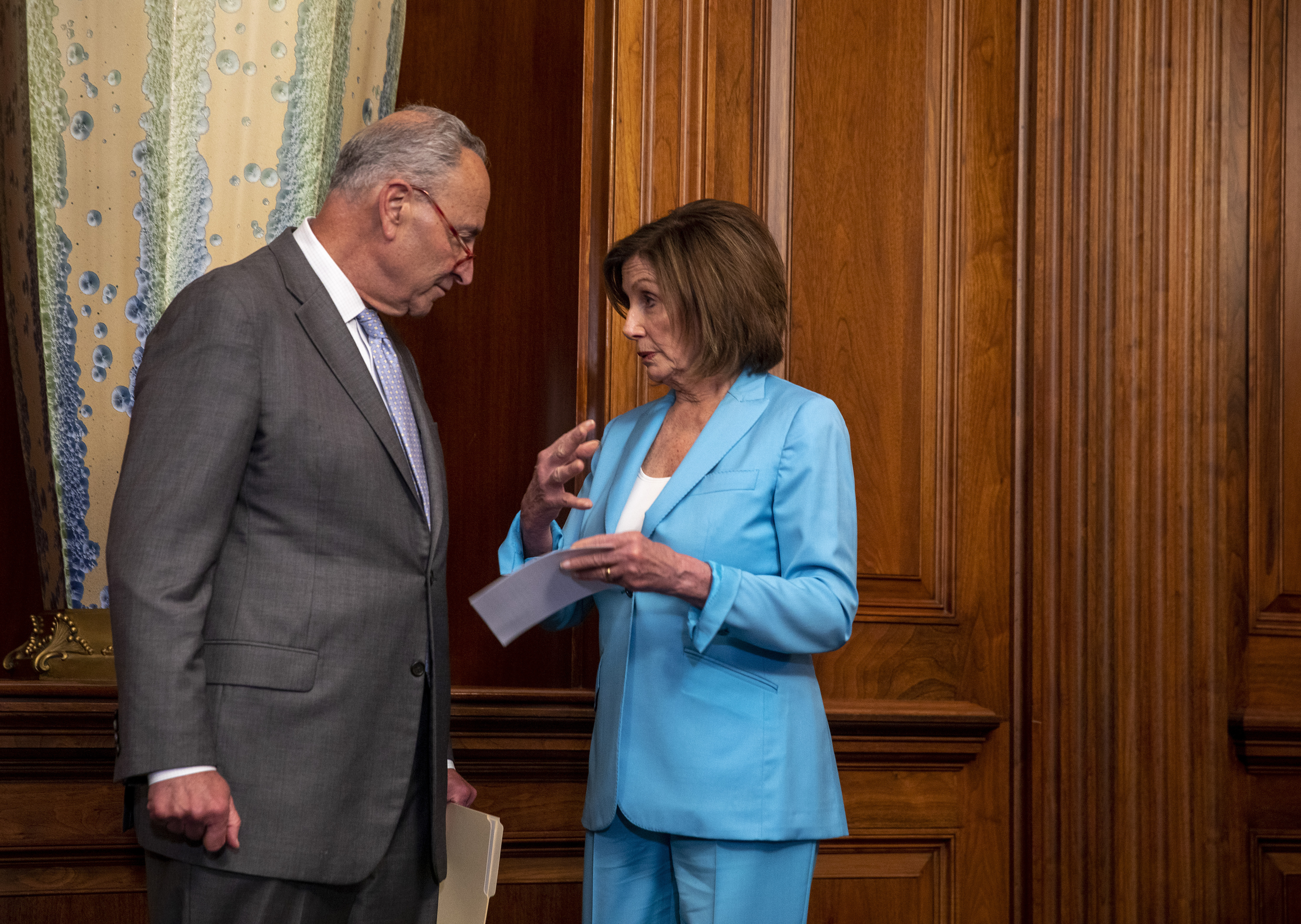 U.S. Senate Minority Leader Chuck Schumer and U.S. House Speaker Nancy Pelosi chat at a press conference on passing the America's Elections Act on June 26, 2019 in Washington, DC. (Photo by Tasos Katopodis/Getty Images)