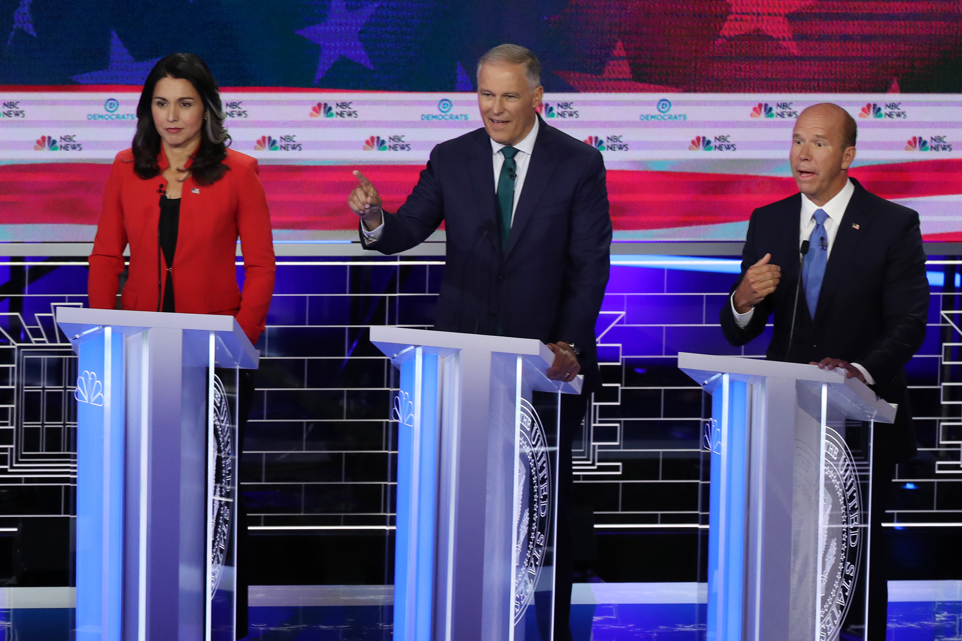 (L-R) Rep. Tulsi Gabbard, Washington Gov. Jay Inslee and former Maryland congressman John Delaney take part in the first night of the Democratic presidential debate on June 26, 2019 in Miami, Florida. (Photo by Joe Raedle/Getty Images)