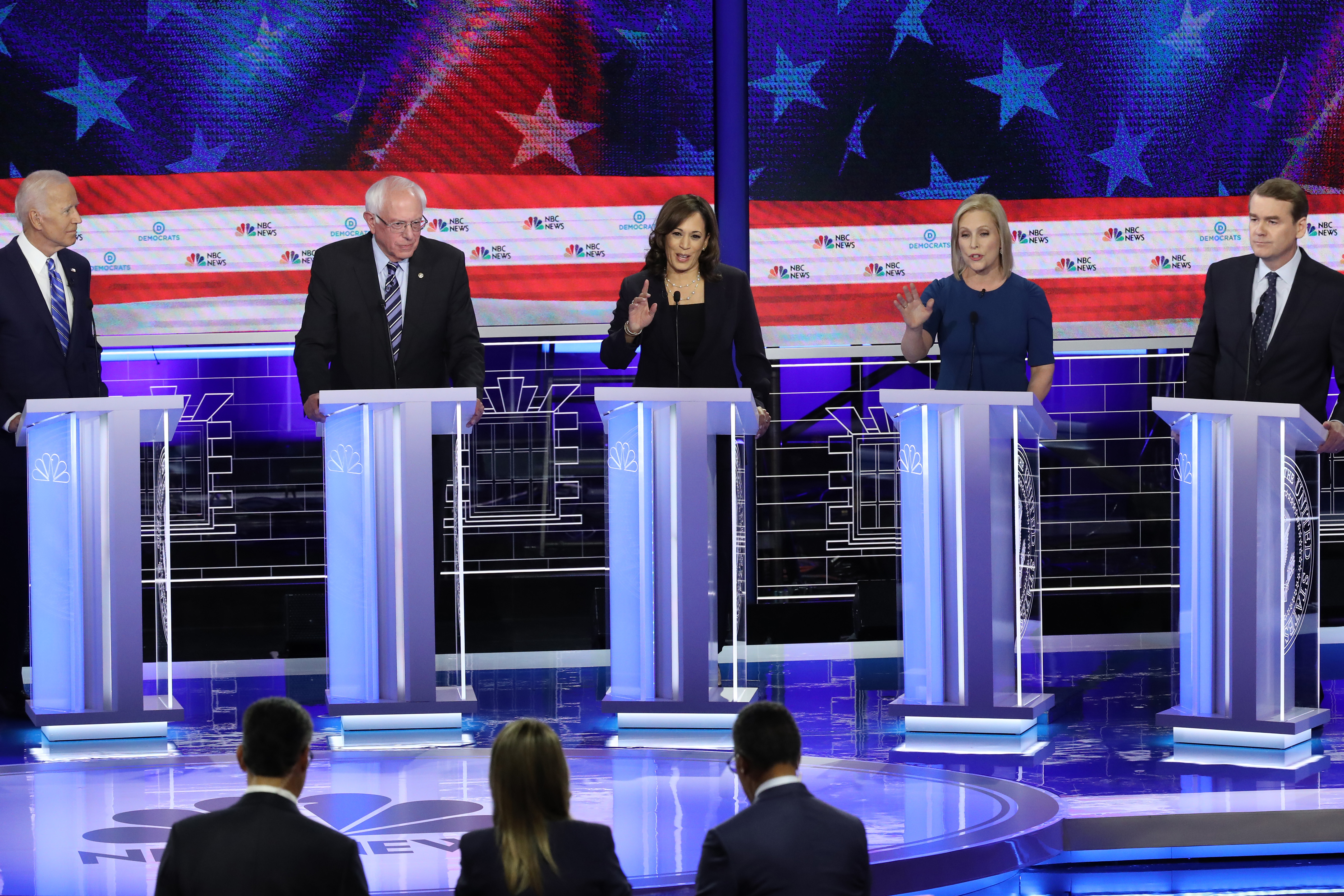 Democratic presidential candidates (L-R) former Vice President Joe Biden, Sen. Bernie Sanders, Sen. Kamala Harris, Sen. Kirsten Gillibrand and Sen. Michael Bennet take part in the second night of the first Democratic presidential debate on June 27, 2019 in Miami, Florida. (Photo by Drew Angerer/Getty Images)