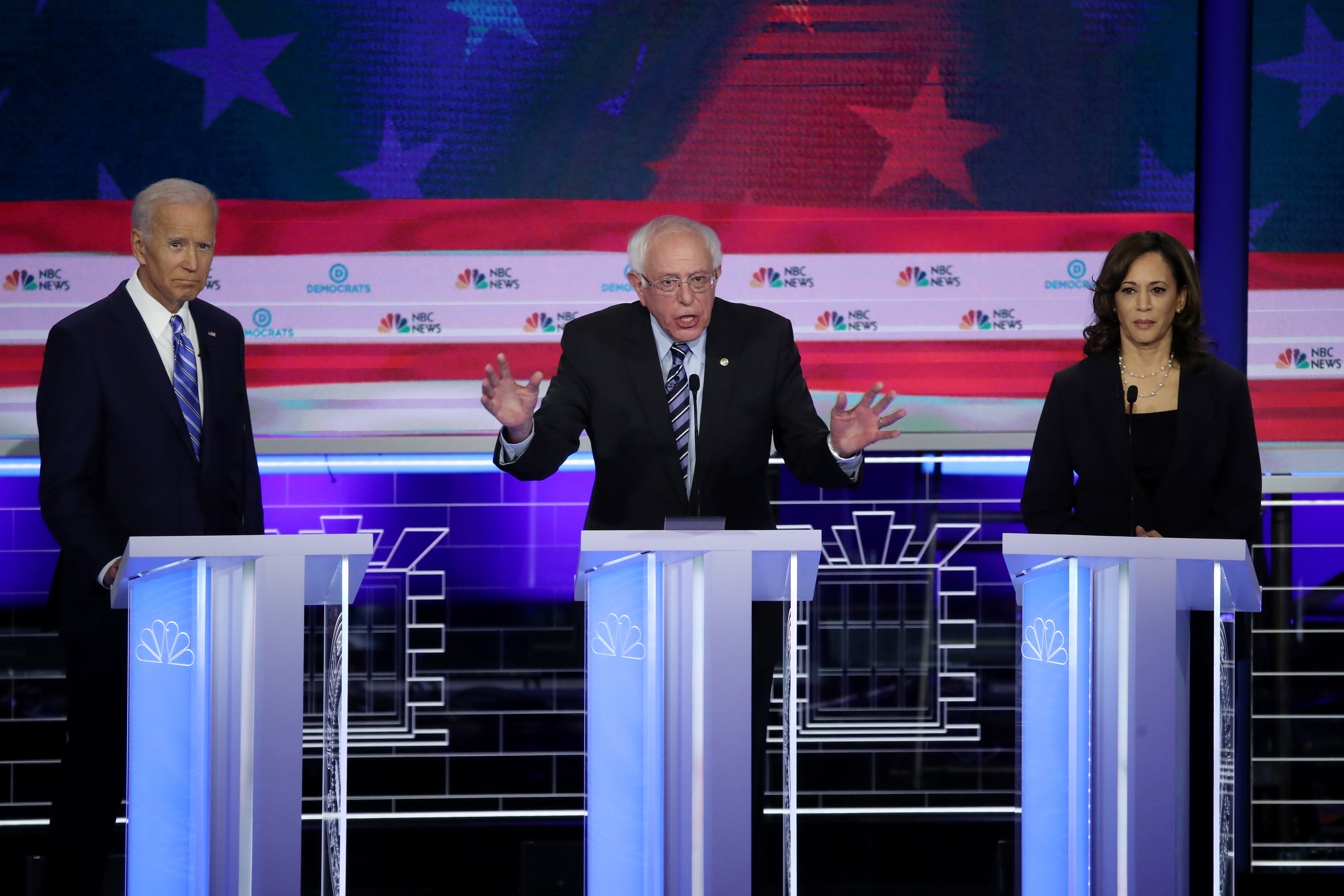 Democratic presidential candidates (L-R) former Vice President Joe Biden, Sen. Bernie Sanders and Sen. Kamala Harris take part in the second night of the first Democratic presidential debate on June 27, 2019 in Miami, Florida. (Photo by Drew Angerer/Getty Images)