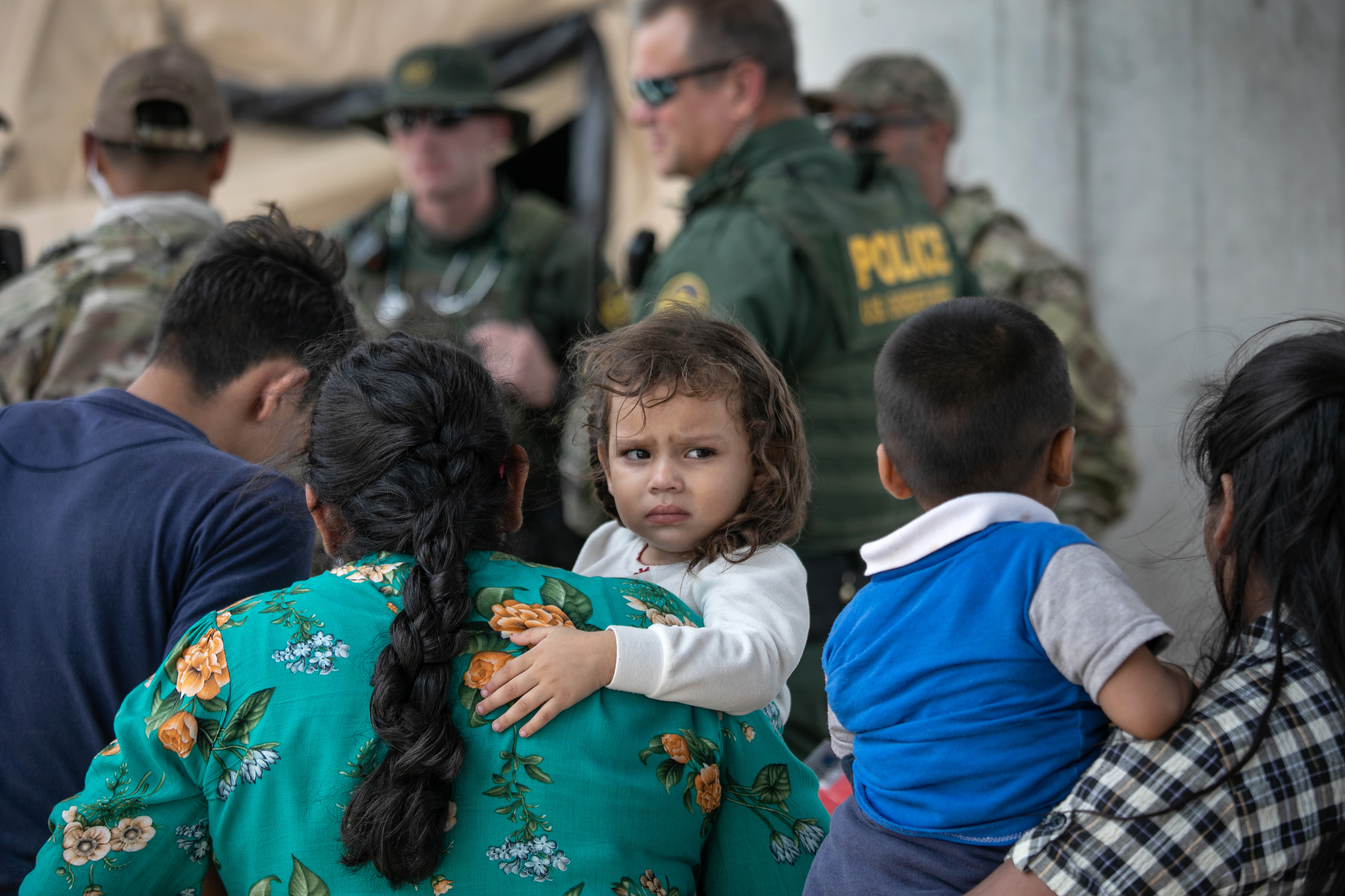 Immigrants wait to be interviewed by U.S. Border Patrol agents after they were taken into custody on July 02, 2019 in McAllen, Texas. (John Moore/Getty Images)
