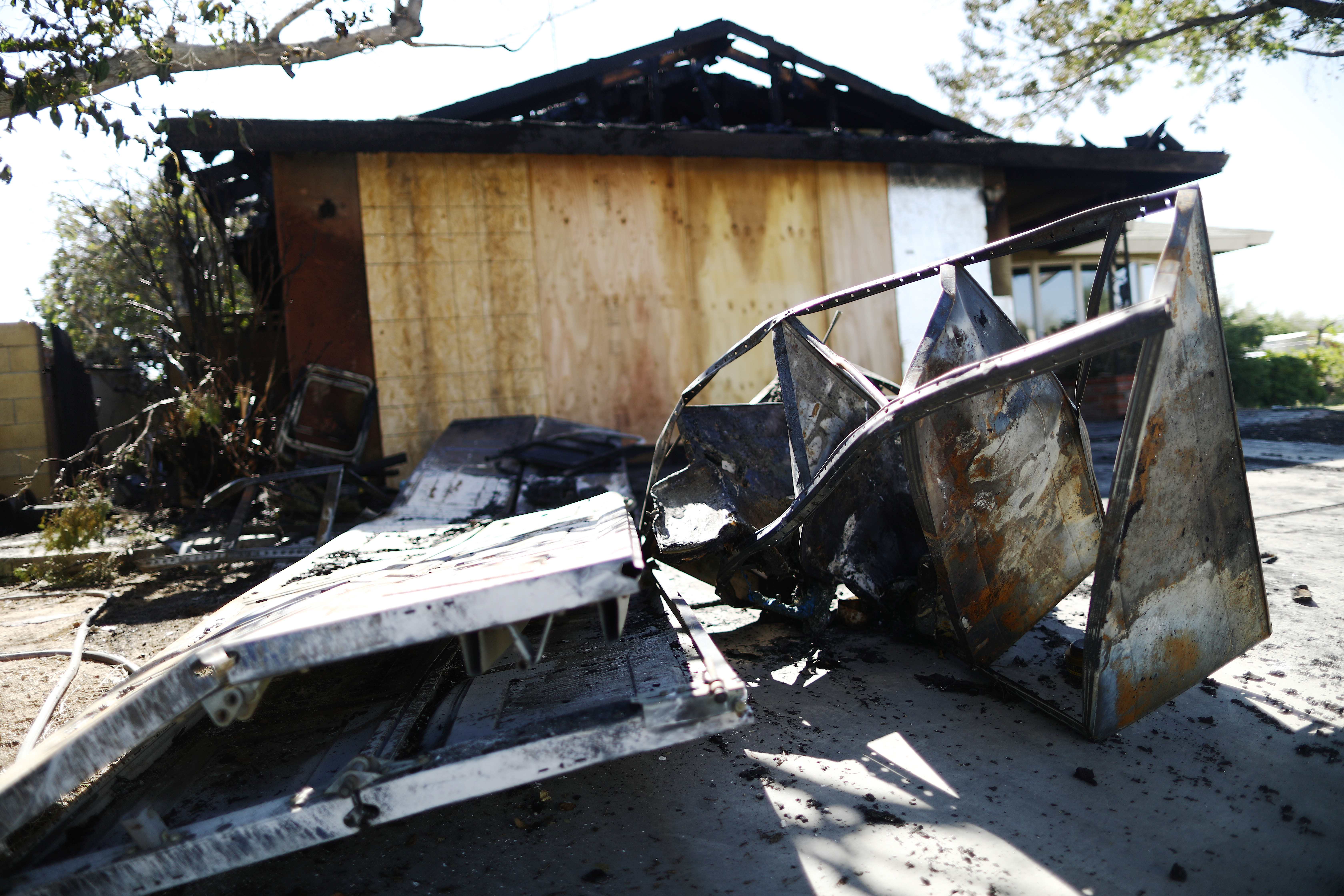 Charred items sit in front of a home which caught fire following a 6.4 magnitude earthquake on July 4, 2019 in Ridgecrest, California. The earthquake was the largest to strike Southern California in 20 years with the epicenter located in a remote area of the Mojave Desert. The temblor was felt by residents across Southern California. (Photo by Mario Tama/Getty Images)