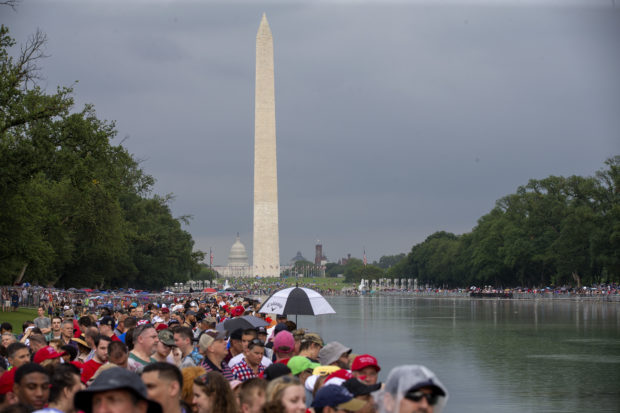 "WASHINGTON, DC - JULY 04: Guests wait for President Trump to take the stage on July 04, 2019 in Washington, DC. President Trump is holding a ""Salute to America"" celebration on the National Mall on Independence Day this year with musical performances, a military flyover, and fireworks. (Photo by Tasos Katopodis/Getty Images)"