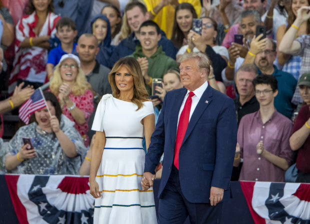 "WASHINGTON, DC - JULY 04: President Donald Trump and first lady Melania Trump take the stage on July 04, 2019 in Washington, DC. President Trump is holding a ""Salute to America"" celebration on the National Mall on Independence Day this year with musical performances, a military flyover, and fireworks. (Photo by Tasos Katopodis/Getty Images)"