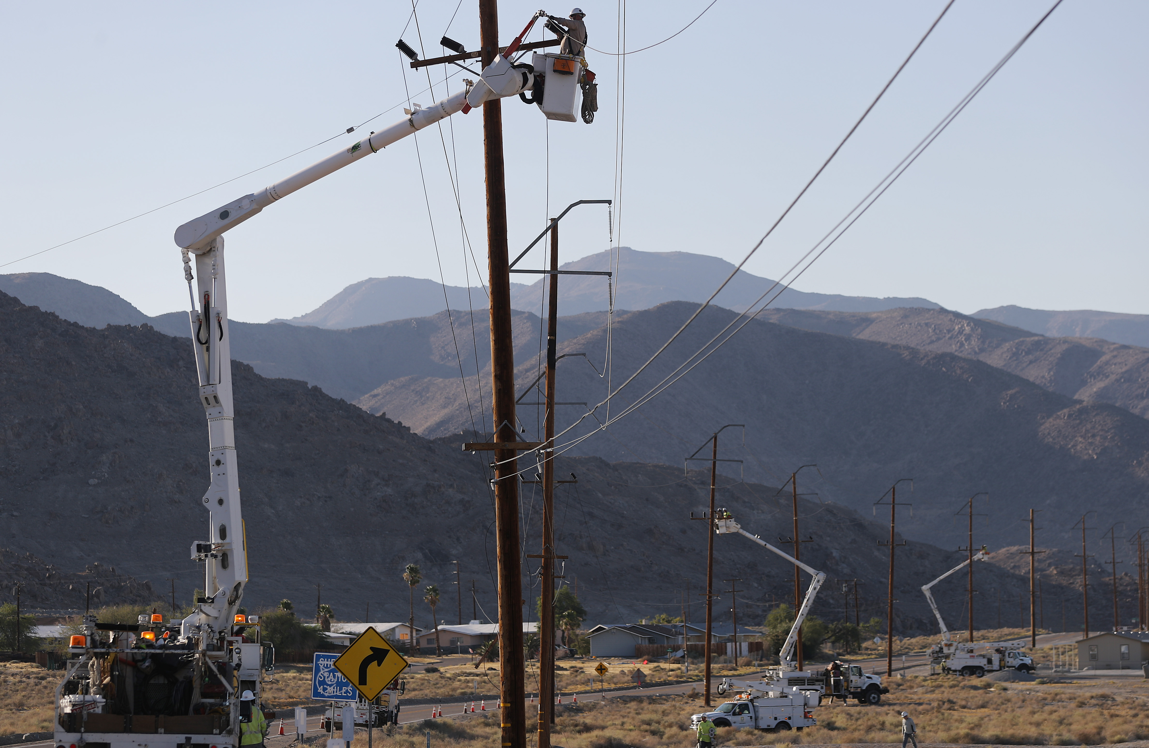 Workers repair damaged utility lines after a 6.4 magnitude earthquake struck the area on July 4, 2019 in Trona, California. The earthquake was the largest to strike Southern California in 20 years with the epicenter located in a remote area of the Mojave Desert. The temblor was felt by residents across much of Southern California. (Photo by Mario Tama/Getty Images)