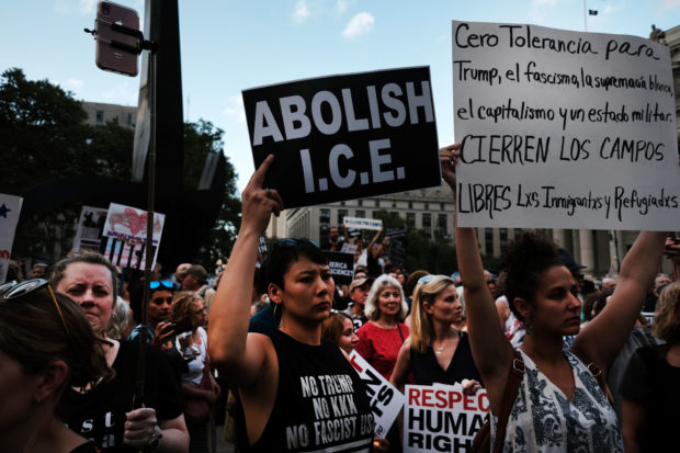 "NEW YORK, NY - JULY 12: Hundreds of people gather in lower Manhattan for a ""Lights for Liberty"" protest against migrant detention camps and the impending raids by Immigration and Customs Enforcement (ICE) this coming weekend in various cities on July 12, 2019 in New York City. Fear is increasing in many immigrant neighborhoods as ICE is scheduled to begin rounding up illegal immigrants in cities across the nation starting on Sunday. (Photo by Spencer Platt/Getty Images)"