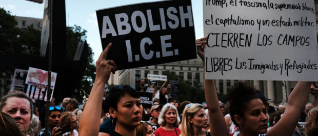 "Hundreds of people gather in lower Manhattan for a ""Lights for Liberty"" protest against migrant detention camps and the impending raids by Immigration and Customs Enforcement (ICE) this coming weekend in various cities on July 12, 2019 in New York City. (Photo by Spencer Platt/Getty Images)"